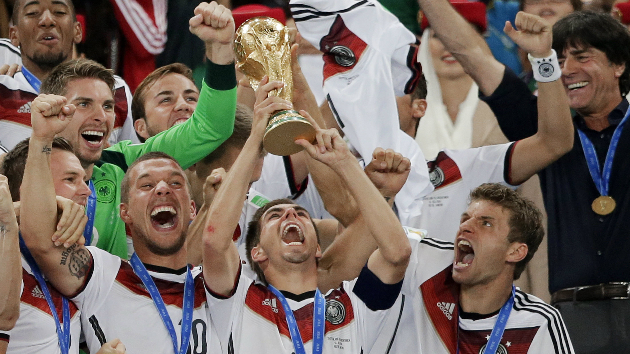 German players celebrate with their trophy after the World Cup final soccer match between Germany and Argentina at the Maracana Stadium in Rio de Janeiro, Brazil, Sunday, July 13, 2014