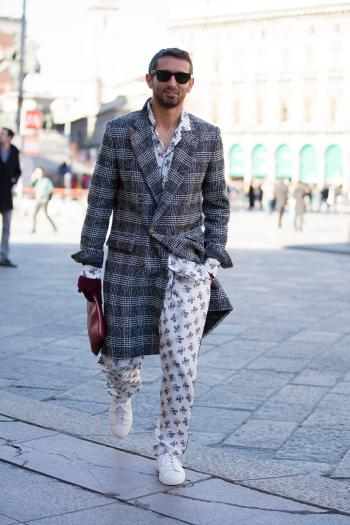 MILAN, ITALY - JANUARY 16: Simone Marchetti wears Ray-Ban sunglasses and Dolce & Gabbana and Ami Paris by Alexandre Mattiussi gray plaid coat and a white floral print silk pajama-style top and pants and white sneakers during the Milan Men's Fashion Week Fall/Winter 2016/17 on January 16, 2016 in Milan, Italy. (Photo by Melodie Jeng/Getty Images)