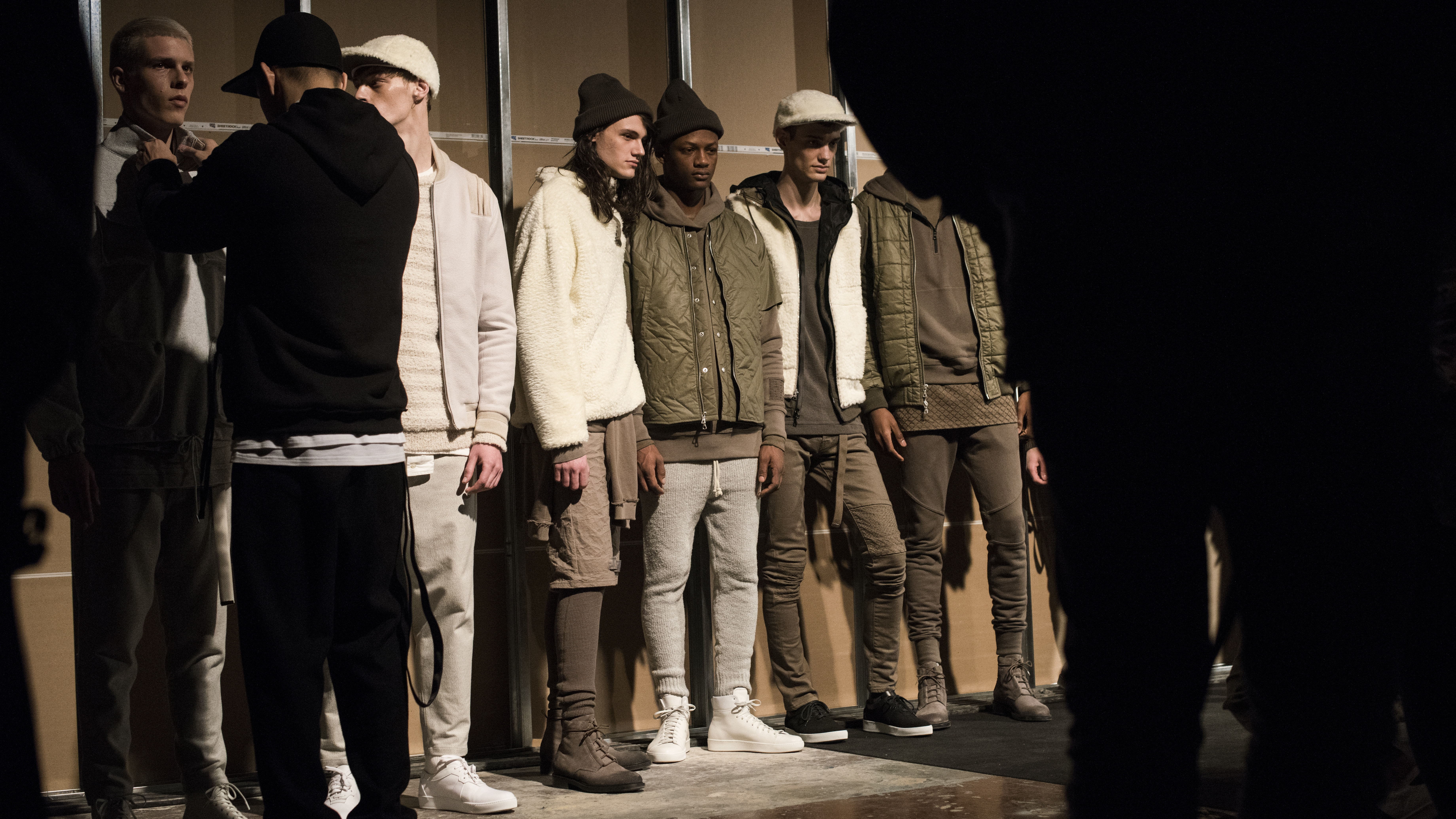 Models stand backstage at the John Elliott + CO fashion show during New York Fashion Week Men's Fall/Winter 2016 at Skylight at Clarkson Sq on February 4, 2016 in New York City. (Photo by Ali Smith/Getty Images)