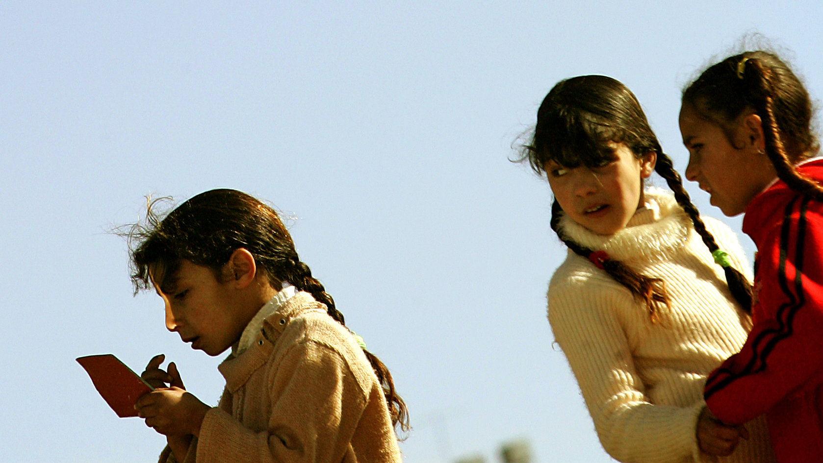 Palestinian girls check their make-up outside a polling station in Hebron January 21, 2006. Palestinian security forces cast the first ballots on Saturday in the Palestinian Legislative Council election, voting early before the main national poll next week, the first contested by the militant group Hamas. PICTURES OF THE MONTH JANUARY 2006 REUTERS/Damir Sagolj
