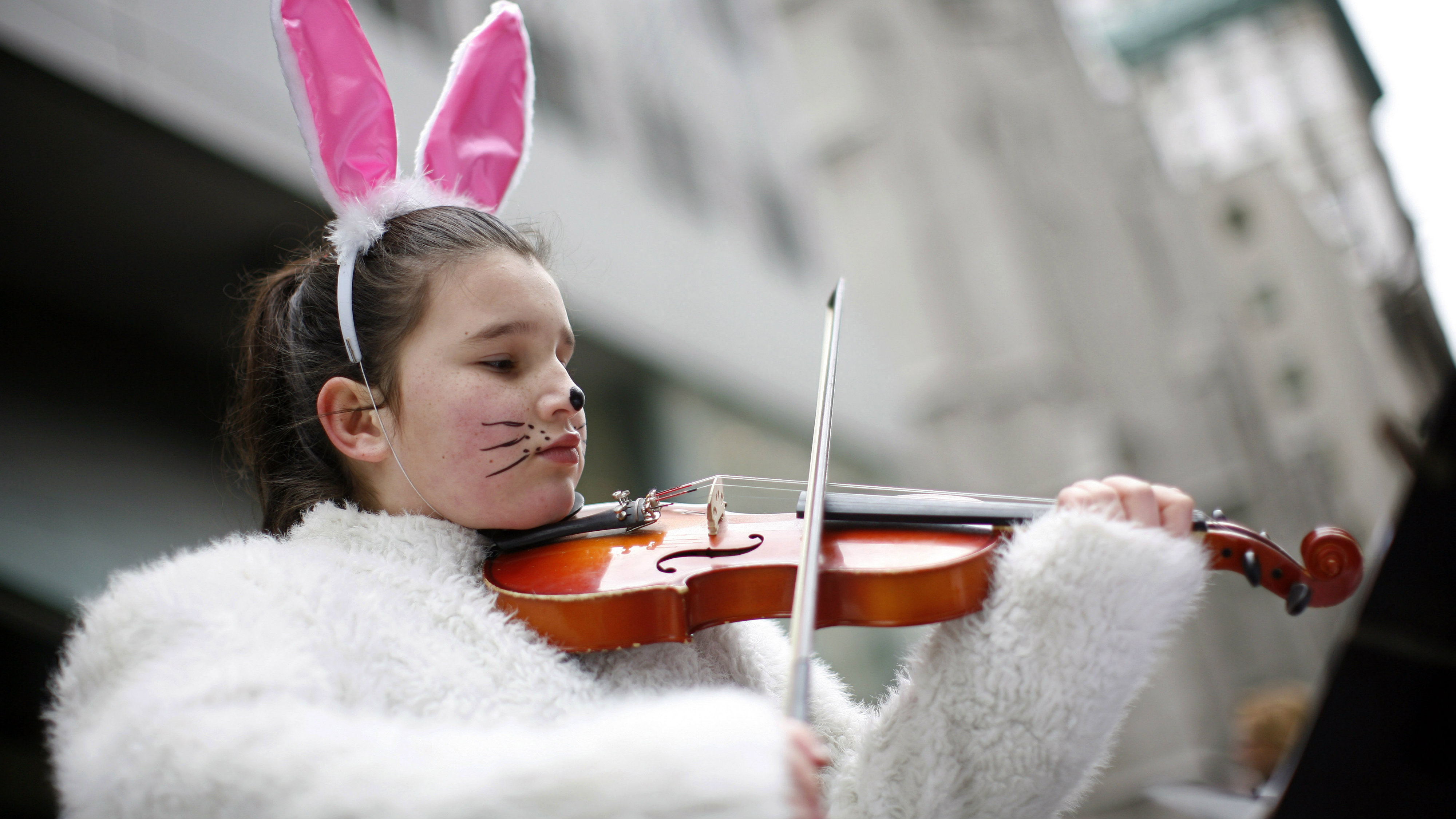 Girl playing violin in bunny costume