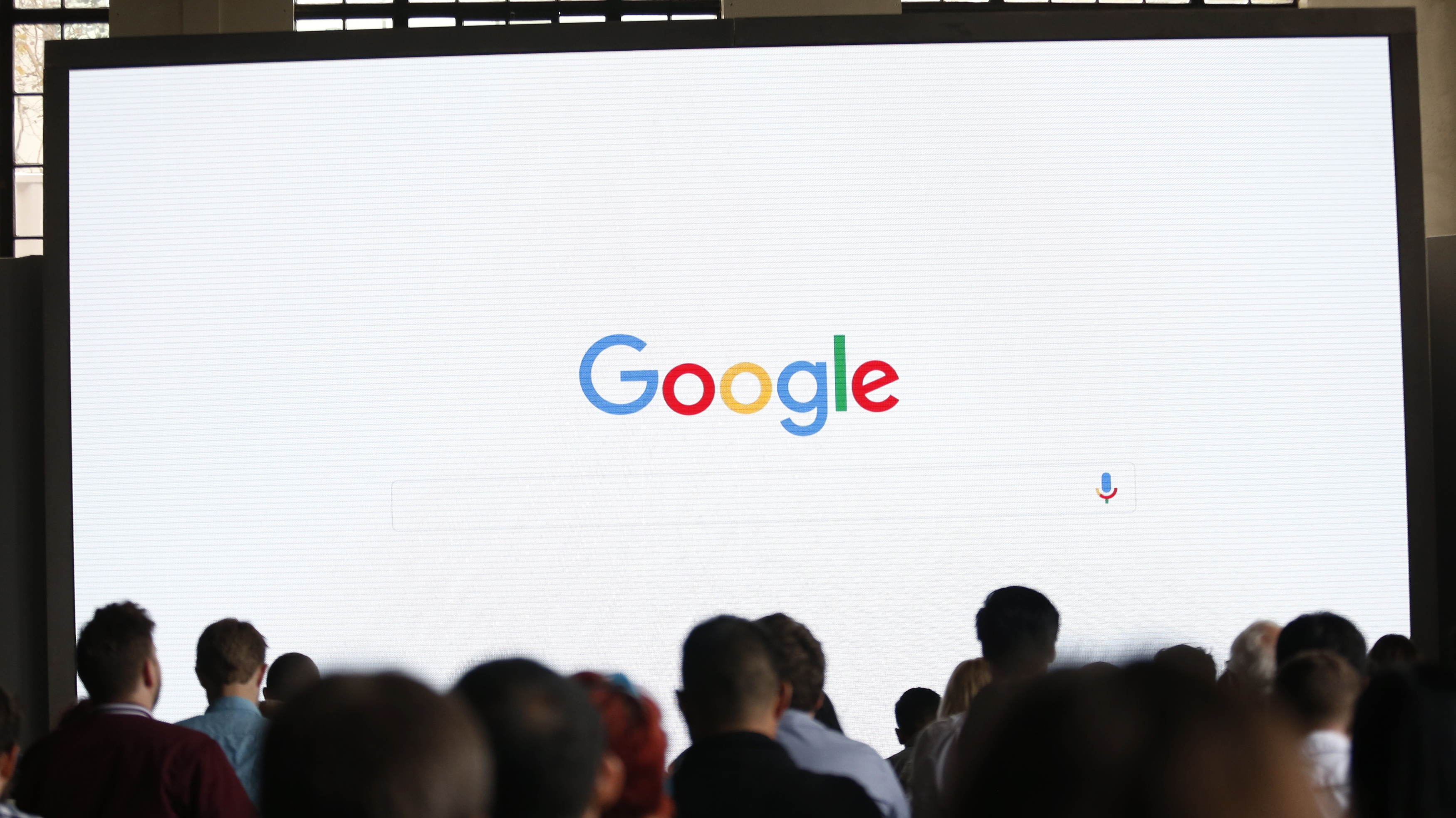 Attendees wait for the program to begin during the presentation of new Google hardware in San Francisco...