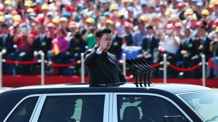 Chinese President Xi Jinping waves from a car as he reviews troops on Tiananmen Square during the military parade marking the 70th Anniversary of the Victory of Chinese People's Resistance against Japanese Aggression and World Anti-Fascist War at Tiananmen Square in Beijing, China, 03 September 2015. China holds a military parade on 03 September, as one of the events taking place around the World marking the 70th Anniversary of the WWII Victory over Japan Day which marks the day Japan officially accepted the terms of surrender imposed by the by Allied Forces in the Pacific conflict.