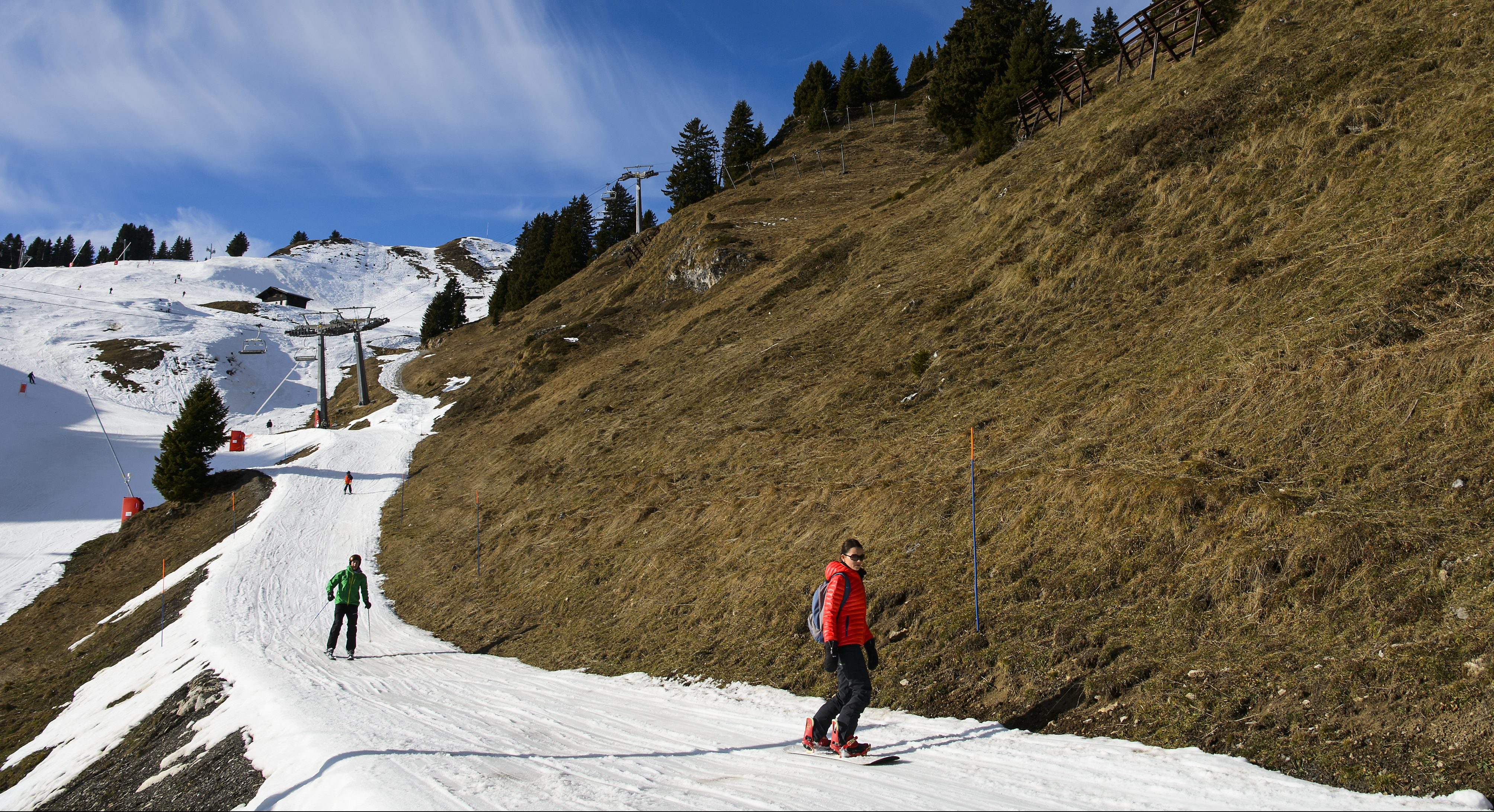 Skiers enjoy the sunny and dry weather at the Villars-Gryon ski resort in Switzerland.