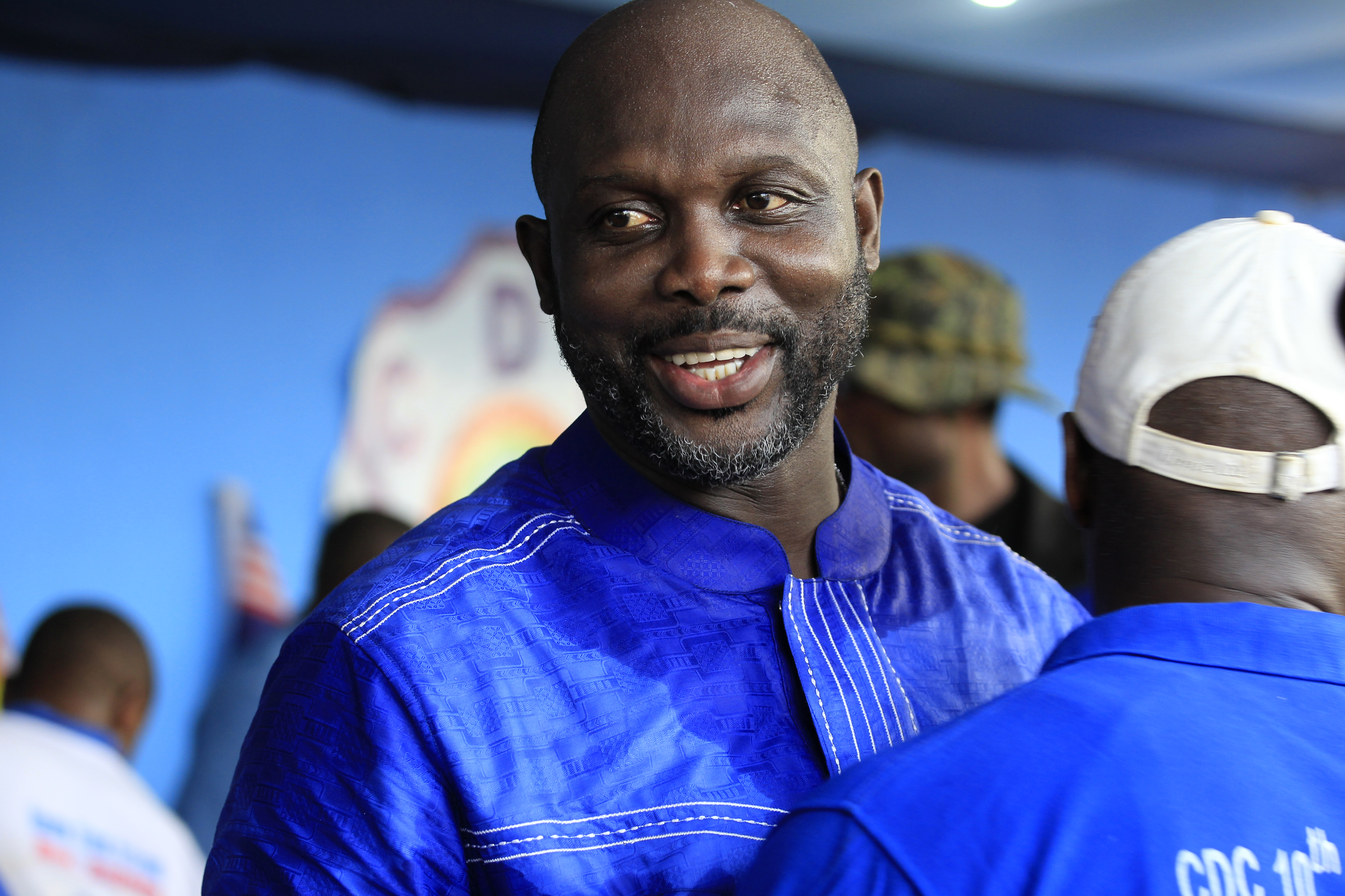 Former Liberian soccer player and current Senator George Weah smiles after addressing thousands of supporters of the Congress for Democratic Change (CDC) party who petitioned him to contest Liberia's Presidential elections in 2017, at Party headquarters in Monrovia, Liberia, 28 April 2016. George Weah contested the 2005 and 2011 Presidential elections, but lost to incumbent Ellen Johnson Sirleaf on both occasions. Sirleaf's second term in office will end in 2017.