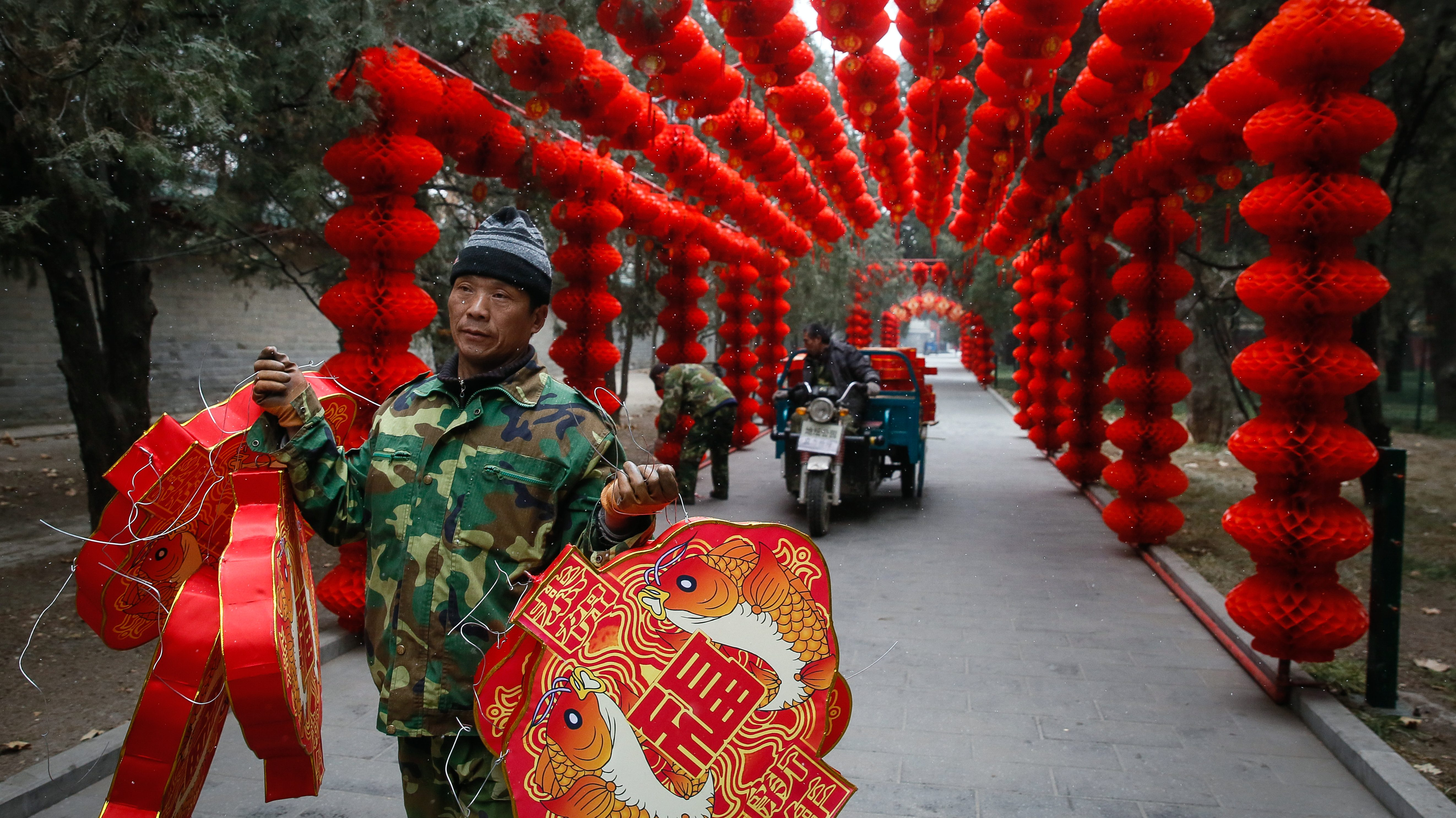 Workers decorate Ditan Park to celebrate the upcoming China Lunar New Year in Beijing, China, 16 January 2017. The Chinese Lunar New Year, or Spring Festival, which falls on 28 January this year will mark the Year of the Rooster.