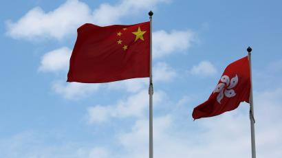 A Chinese national flag and a Hong Kong flag fly outside the Legislative Council in Hong Kong, China November 7, 2016, as China's parliament passed an interpretation of Hong Kong's Basic Law on Monday that says lawmakers must swear allegiance to the city as part of China.
