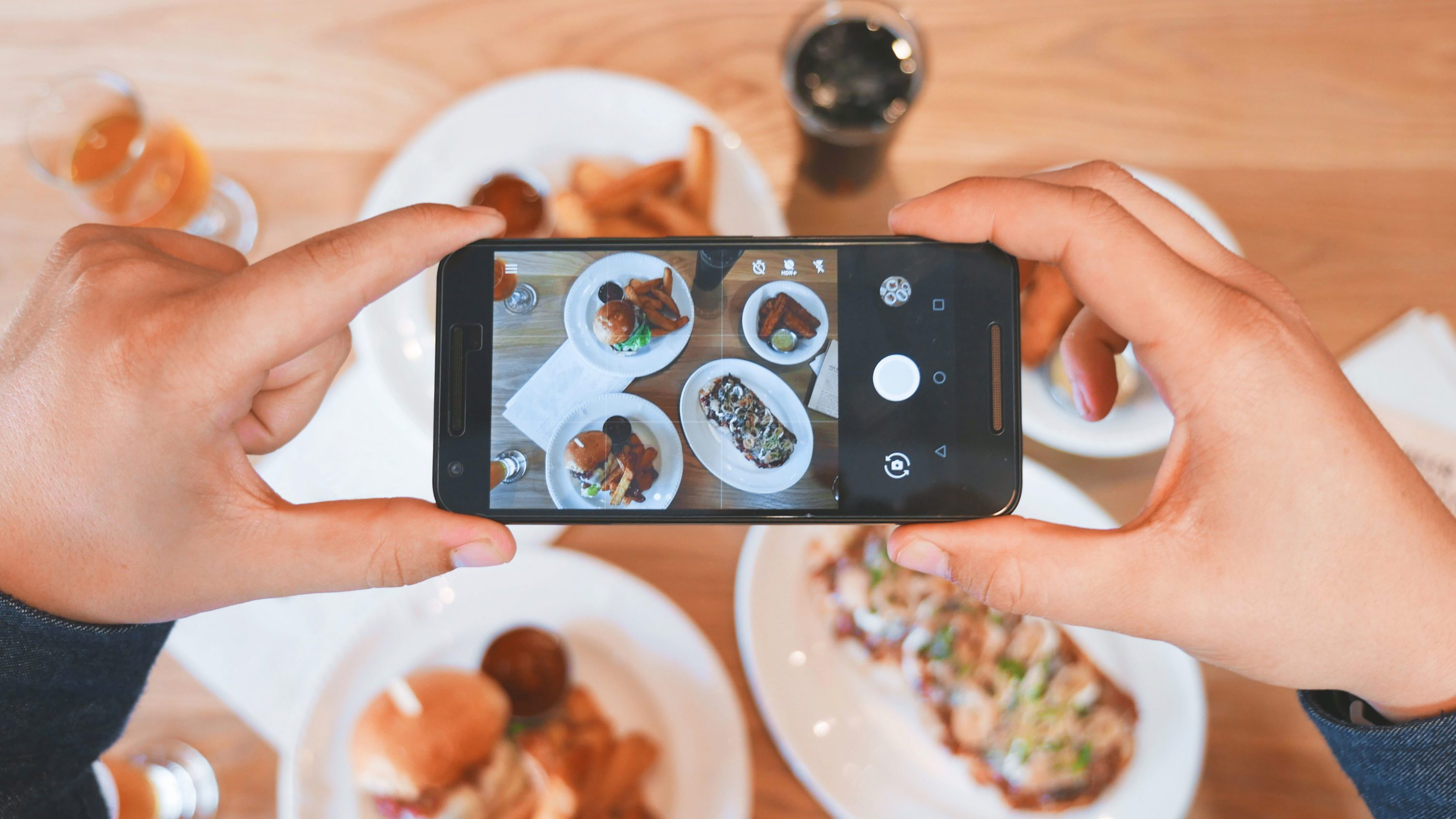 smartphone taking pictures of food