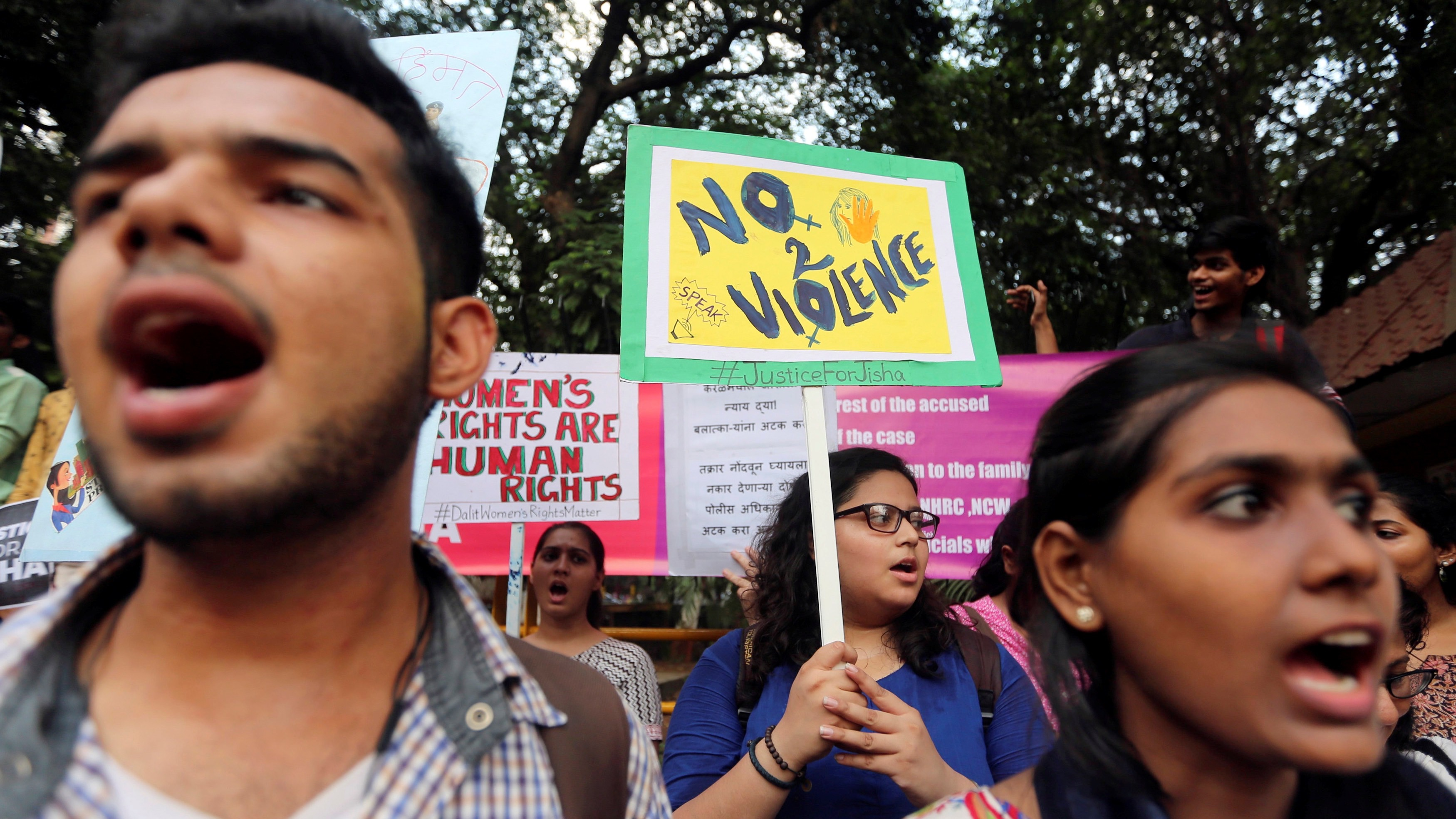 Demonstrators shout slogans during a protest against the rape and murder of a law student in the southern state of Kerala, in Mumbai, India, May 11, 2016. Authorities had released a sketch of a suspect and said they were looking for a man seen leaving the home of the 30-year-old law student. The case has evoked comparisons in the media with the gang rape and torture of a 23-year-old woman in New Delhi in 2012, which sparked nationwide protests. India toughened its anti-rape laws in response to the outcry following the 2012 murder, but rape, acid attacks, domestic violence and molestation are common. REUTERS/Shailesh Andrade - RTX2DU9K