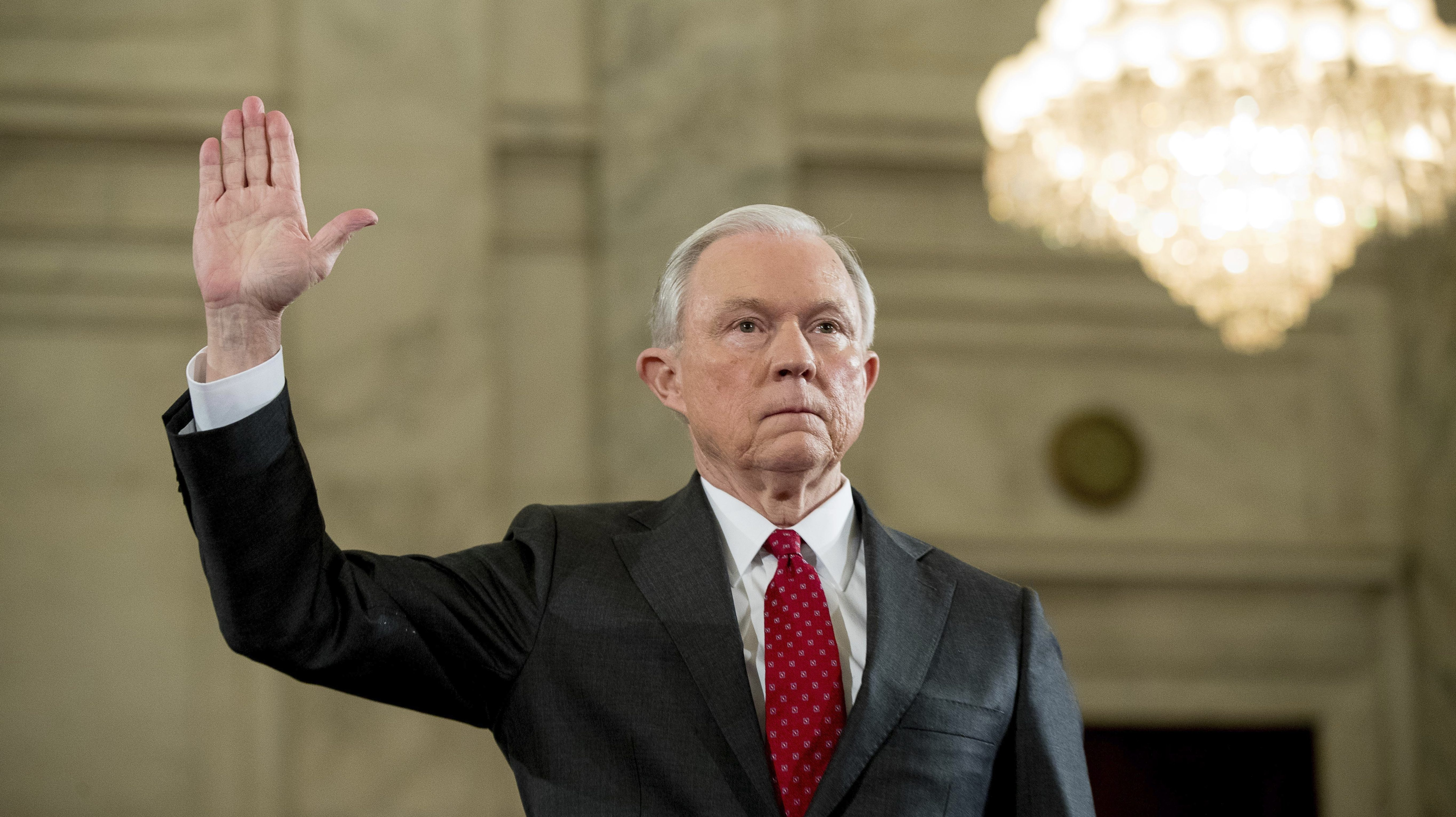 Attorney General-designate, Sen. Jeff Sessions, R-Ala. is sworn in on Capitol Hill in Washington