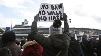 Protesters rally against Donald Trump's immigration ban in front of John F. Kennedy International Airport in New York.