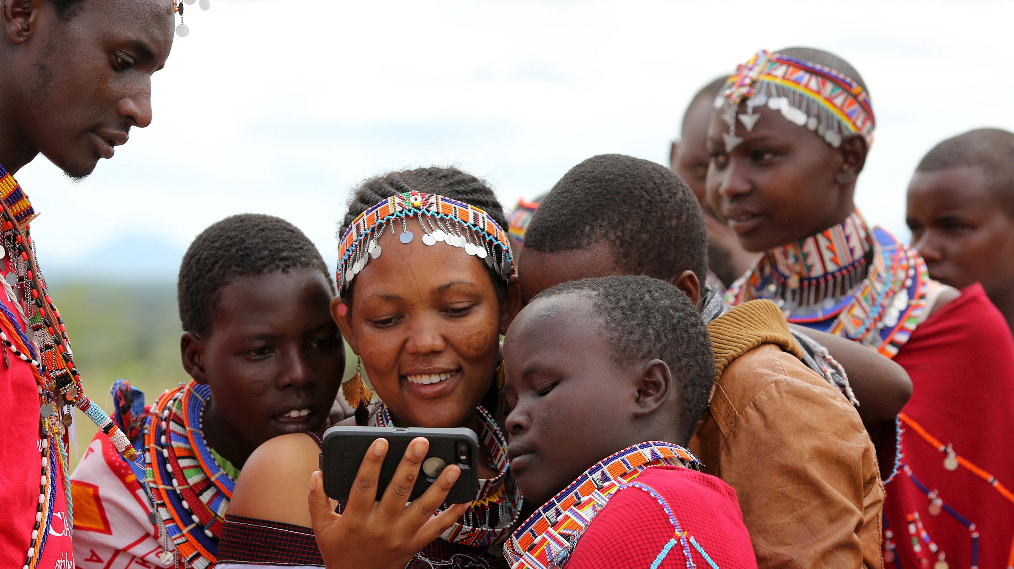 Maasai kids in Kenya watching vids.
