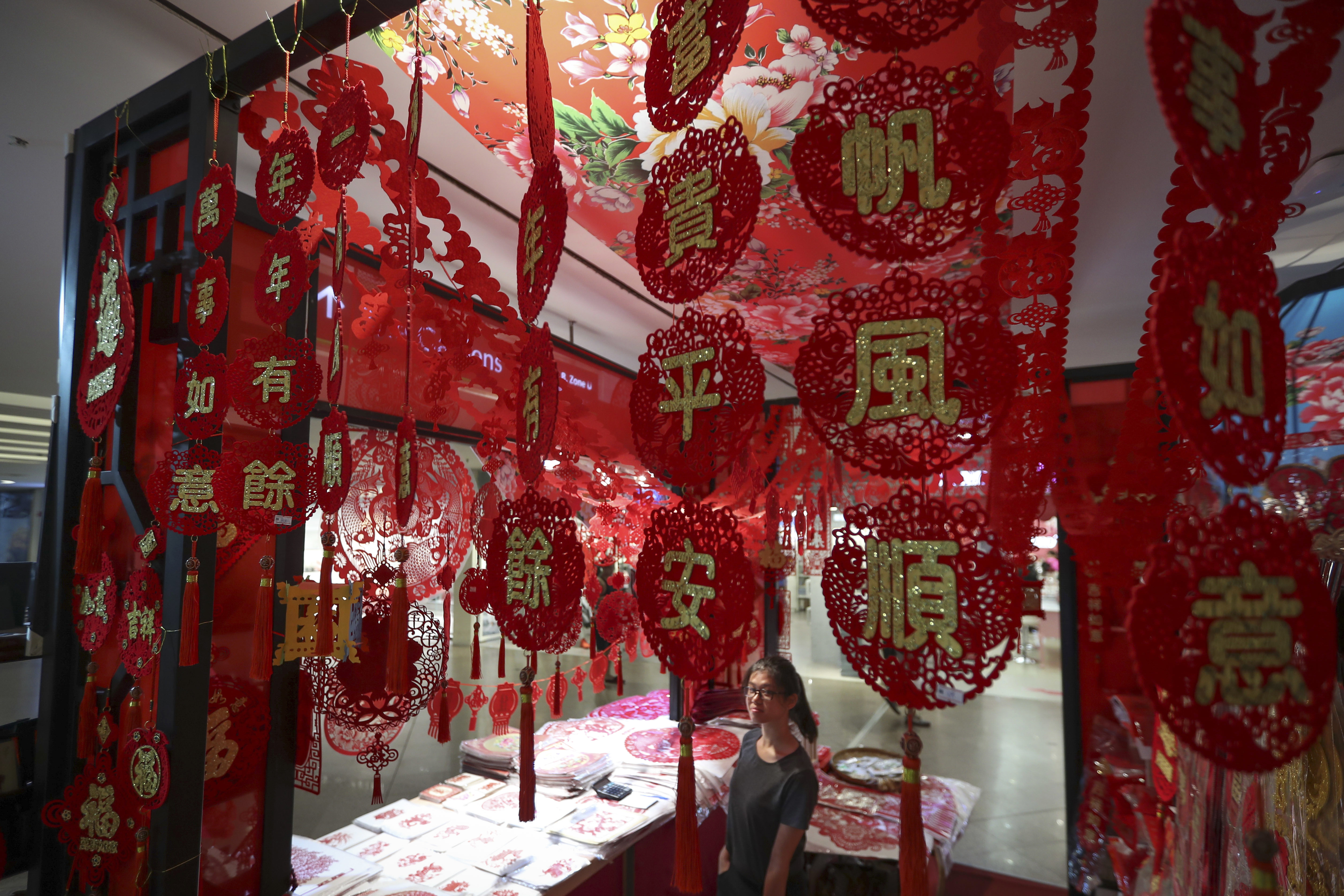 A Malaysian store displays Lunar New Year decorations at a shopping mall in Kuala Lumpur, Malaysia, Monday, Jan. 16, 2017. The Lunar New Year which falls on Jan. 28 this year marks the Year of the Rooster in the Chinese calendar. (AP Photo/Vincent Thian)
