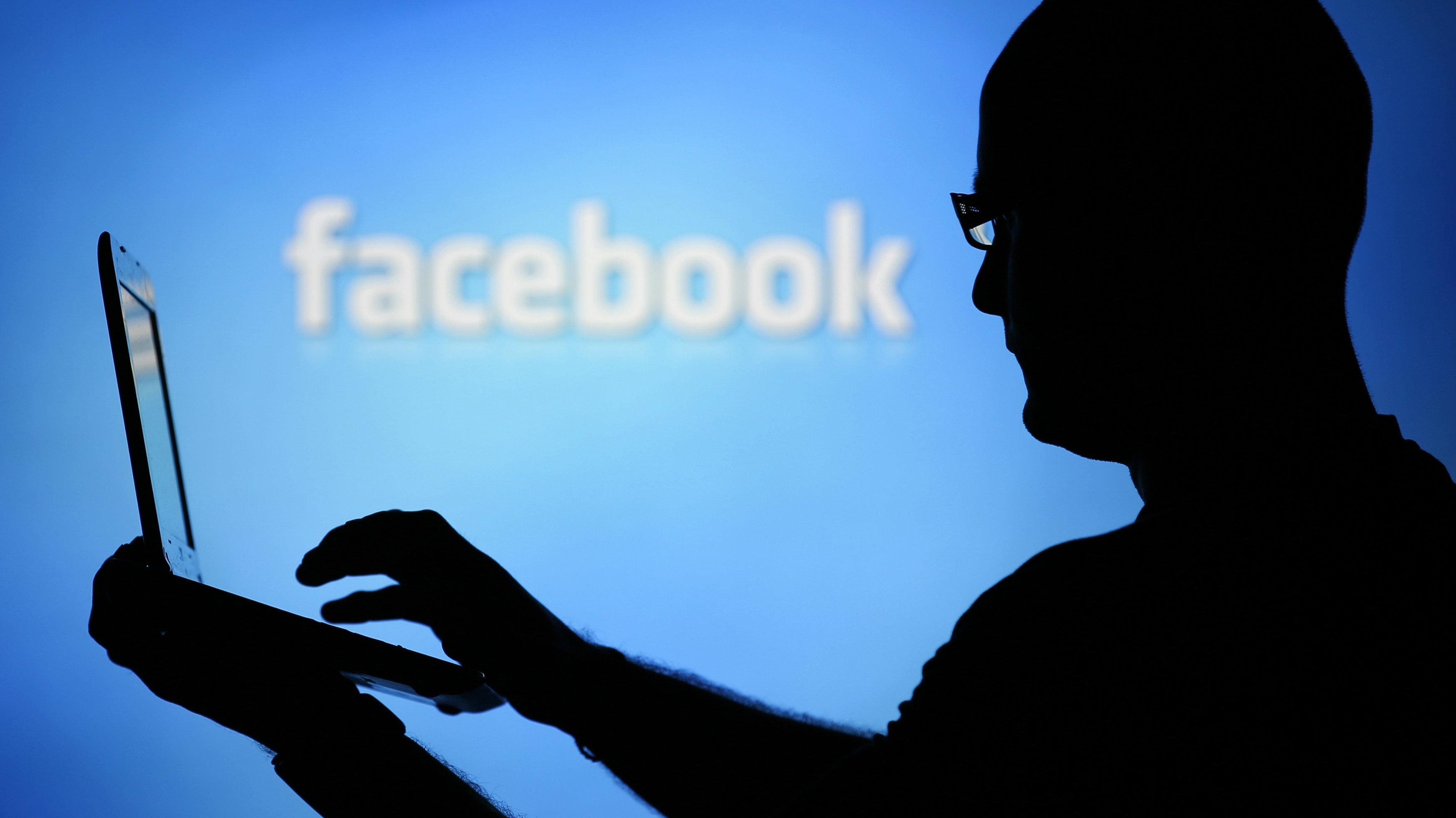 man reading facebook