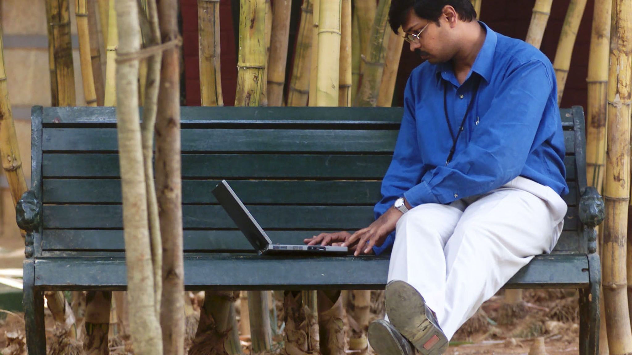 An employee of Infosys Technologies Ltd works on a laptop during his lunch break in Bangalore April 6. Infosys Technologies Ltd is the first Indian software company to be listed on a United States stock exchange. Bangalore today is home to dozens of global and domestic technology companies employing an estimated 75,000 software professionals and is popularly referred to as Asia's 'Silicon Valley'.