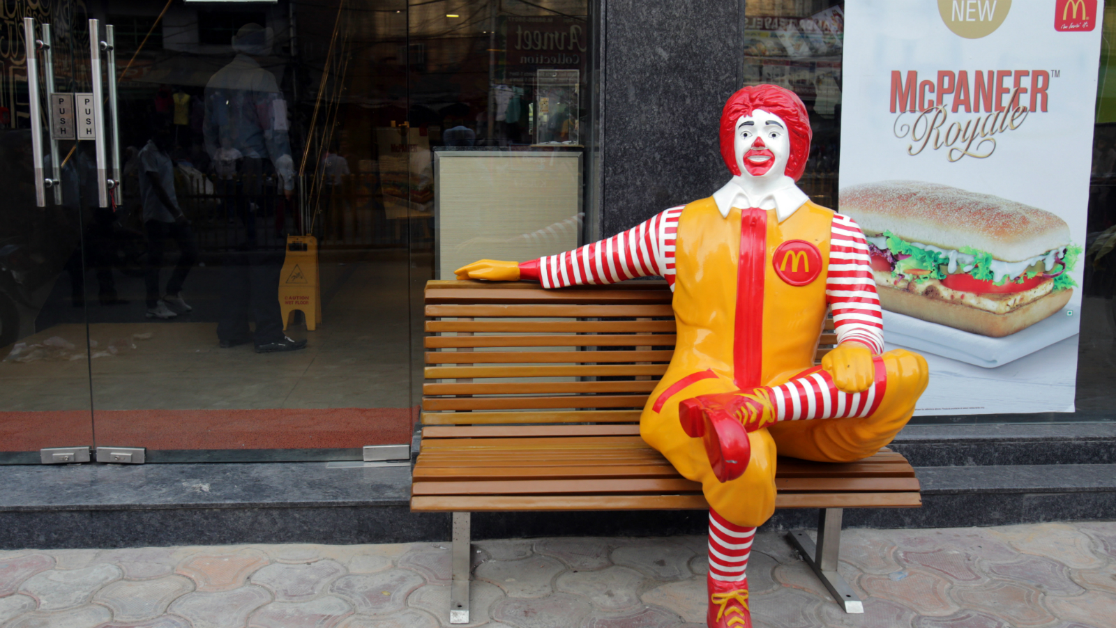 A 'Ronald McDonald' figure sits on a bench outside the newly opened, McDonald's first ever vegetarian-only restaurant near the Golden Temple (not pictured), the holiest of Sikh shrines in Amritsar, India, 12 April 2014. According to news reports, the McDonald's fast food restaurant in Amritsar solely offers vegetarian food in respect of the sanctity of the Sikh's holy city of Amritsar and area near the holiest Sikh shrine.