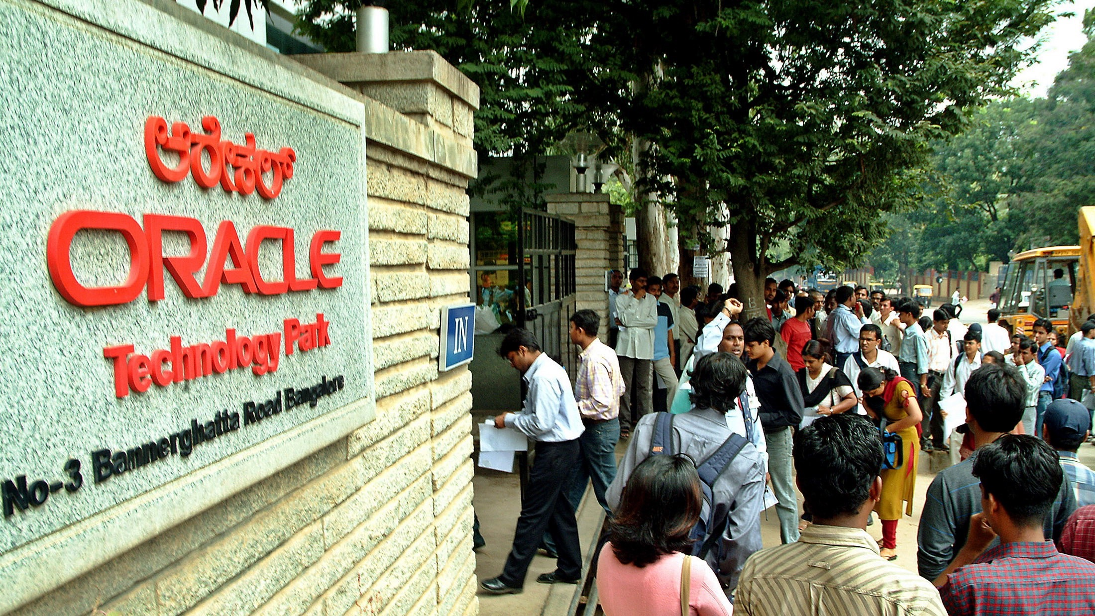 Indian graduates stand outside software company Oracle
