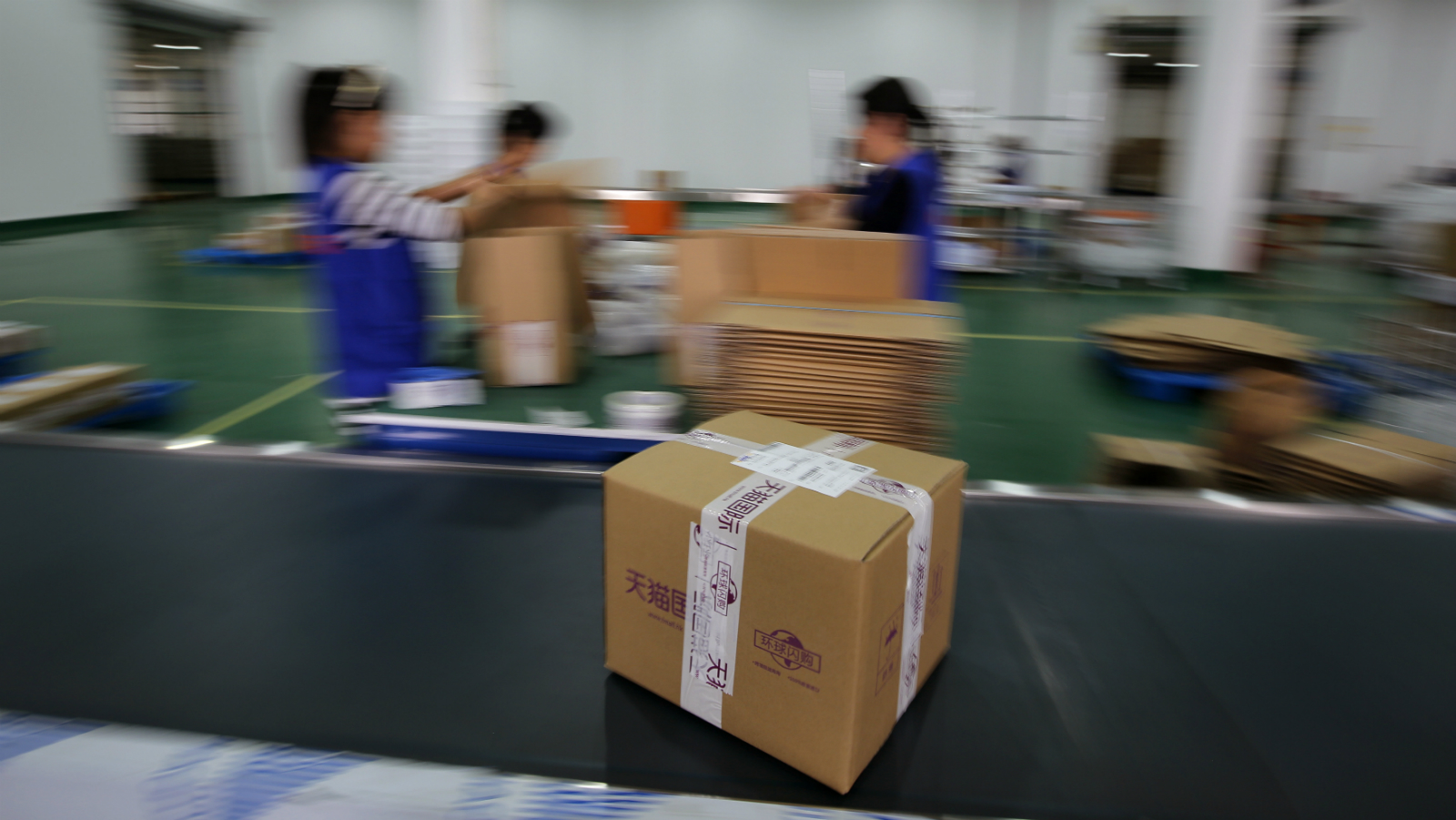 "A box with goods is seen as employees work at an Alibaba Group warehouse on the outskirts of Hangzhou, Zhejiang province October 30, 2014. A trademark spat between Chinese e-commerce giant Alibaba Group Holding Ltd and rival JD.com flared into public view after JD published an Alibaba letter urging publishers to be careful about advertising in promotions for China's annual ""Singles' Day"" spree, the world's largest online shopping day."