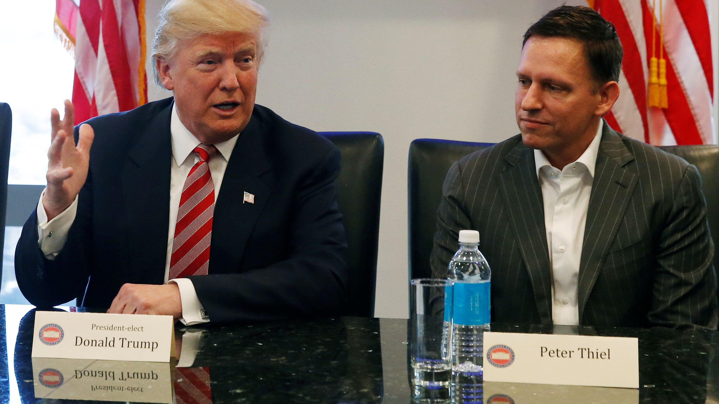 U.S. President-elect Donald Trump sits with PayPal co-founder and Facebook board member Peter Thiel, during a meeting with technology leaders at Trump Tower in New York U.S., December 14, 2016. REUTERS/Shannon Stapleton