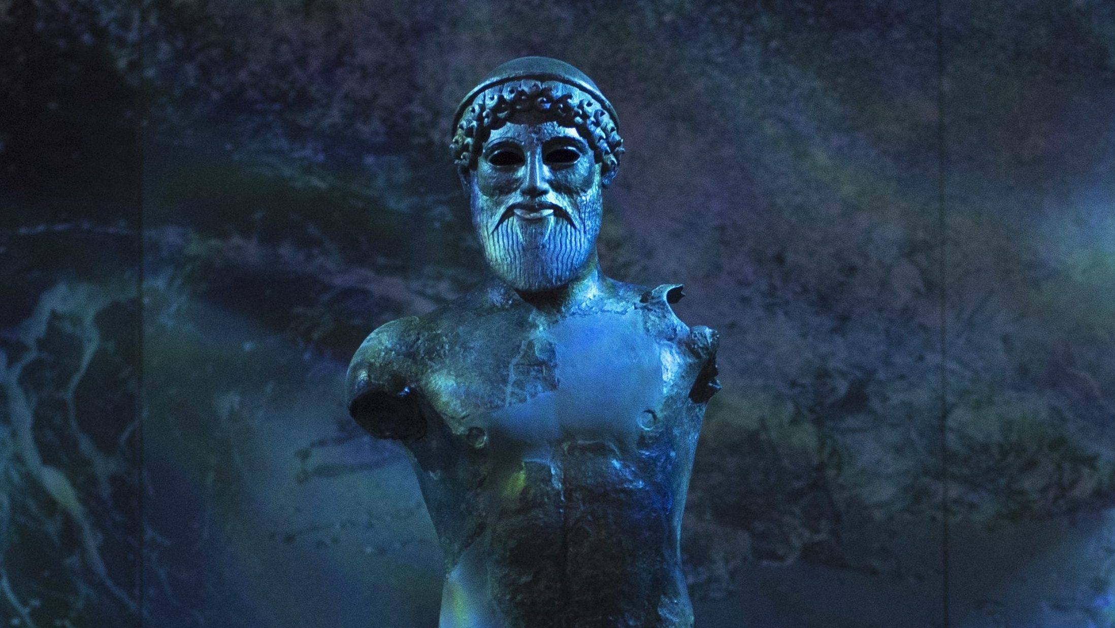 The 480 B.C bronze statue of the ancient Greek god of the sea, Poseidon, is displayed in a new exhibition of the National Archaeological Museum in Athens, on Monday, Sept. 26, 2016.