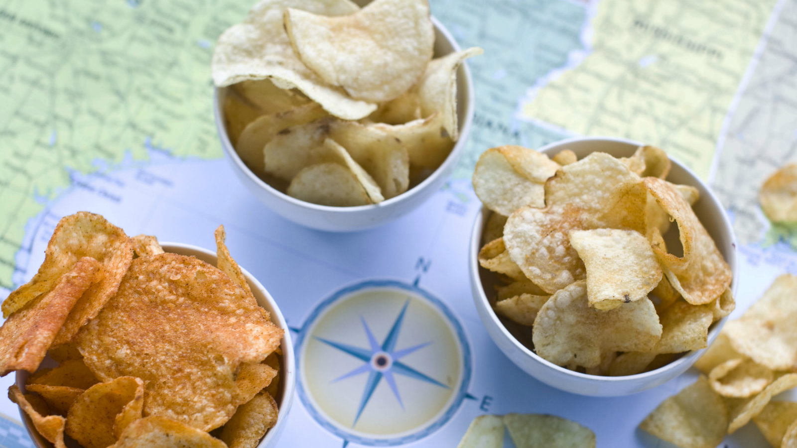 In this image taken on July 30, 2012, from left, Poore Brother's Habanero, Route 11 Chips Chesapeake Crab, and Boulder Canyons Red Wine Vinegar, potato chips are shown in Concord, N.H.