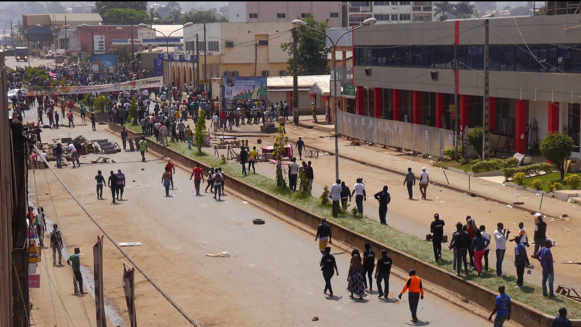Anti-government demonstrators block a road in Bamenda, Cameroon, December 8