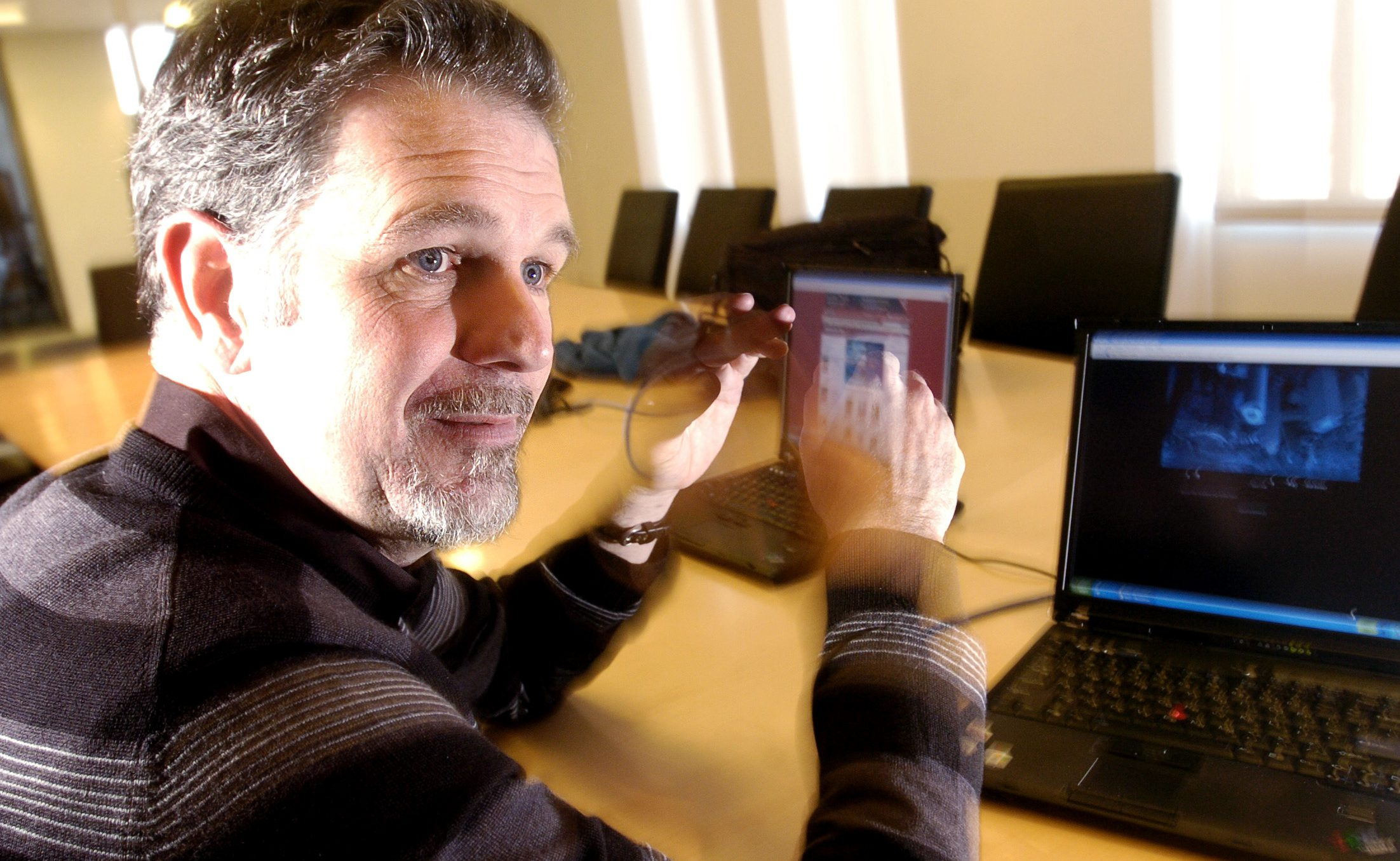 """**HOLD FOR RELEASE 12:01 A.M. EST TUESDAY. THIS STORY MAY NOT BE POSTED ONLINE, BROADCAST OR PUBLISHED BEFORE 12:01 A.M. EST TUESDAY.**  Netflix founder and CEO Reed Hastings demonstrates the """"Watch Now"""" feature on his company's website on Tuesday, Jan. 9, 2007, in Los Gatos, Calif. The company plans to unveil the new feature which allows users to watch movies and TV episodes over the Internet on Tuesday, Jan. 16, 2007, but only a small number of its more than 6 million subscribers will get immediate access to the service, which is being offered at no additional charge. (AP Photo/Noah Berger)   **ONLINE OUT UNTIL 12:01 A.M. EST TUESDAY**"""