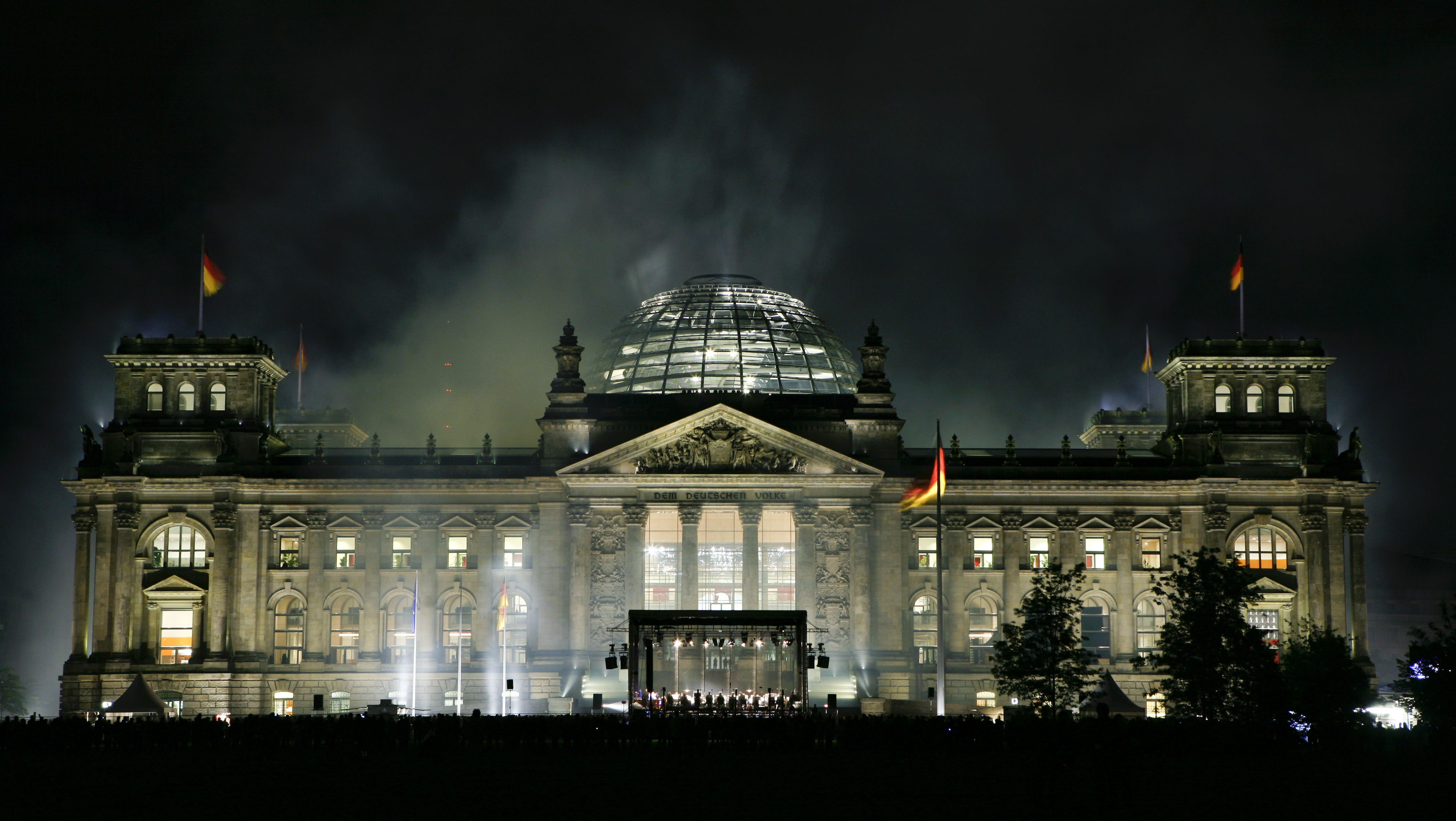 Smoke seen over the Reichstag in Berlin after a fire works to present the new illumination of the building on the eve of Germany's President election on Friday, May 22, 2009.