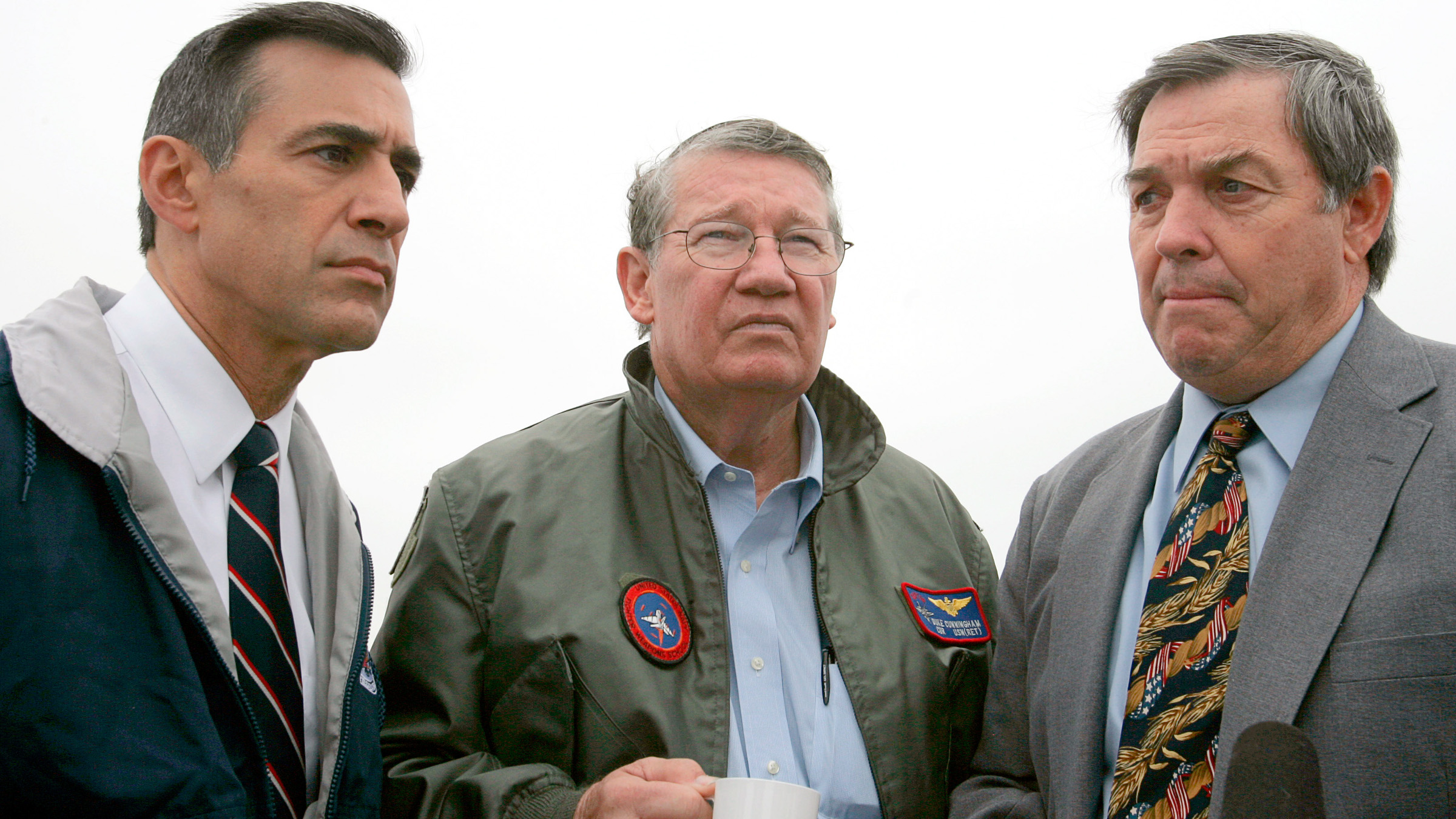 "Congressman Randy ""Duke"" Cunningham (R-San Diego) (C) is flanked by Congressman Darrell Issa (R-San Diego) (L) and Congressman Duncan Hunter (R-San Diego) as they take a ride on the U.S. Navy's fastest large ship, the Sea Fighter, in San Diego, California August 1, 2005. The aluminum-hulled, wave-piercing catamaran will operate at greater than 50 knots and has a range of approximately 4000 nautical miles. The ship is moving to San Diego to continue experimentation while assigned to Commander Naval Surface Force (CNSF) U.S. Third Fleet."