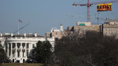 Greenpeace activists display a banner reading 'Resist' from a construction crane near the White House in downtown Washington.
