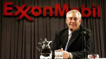 Exxon Mobil Corp. chairman and chief executive Rex W. Tillerson smiles while speaking to reporters during a news conference after the shareholders meeting in Dallas, Wednesday, May 31, 2006.