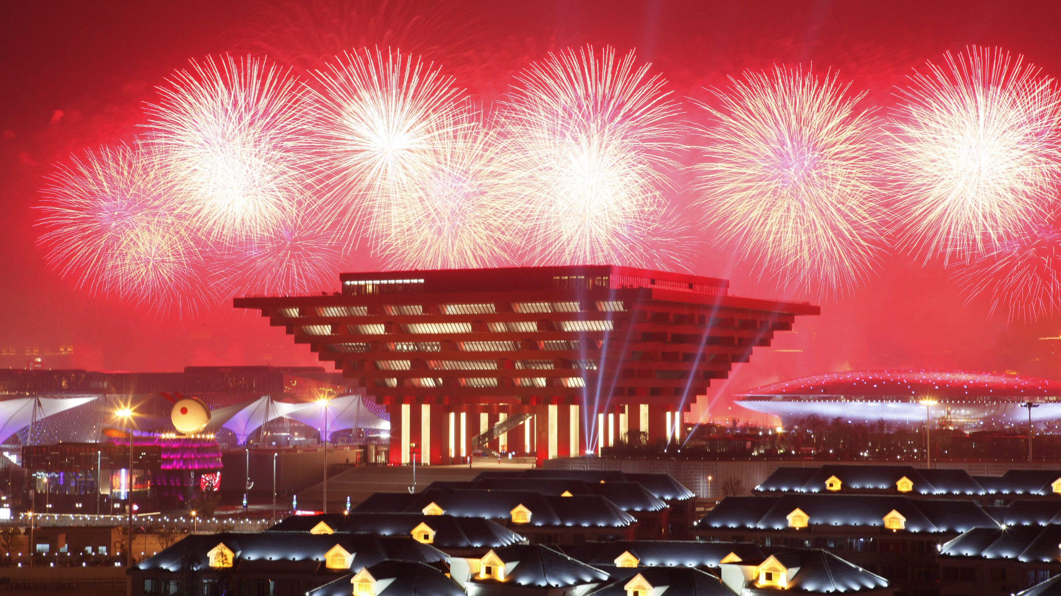 Fireworks explode above the China Pavilion as thousands of visitors watch during the opening ceremony of the Shanghai World Expo April 30, 2010. Shanghai unveils to the world on Friday its multi-billion dollar World Expo, an event many outside the country may struggle to recognise but which China hopes will be an opportunity to assert its growing global clout.