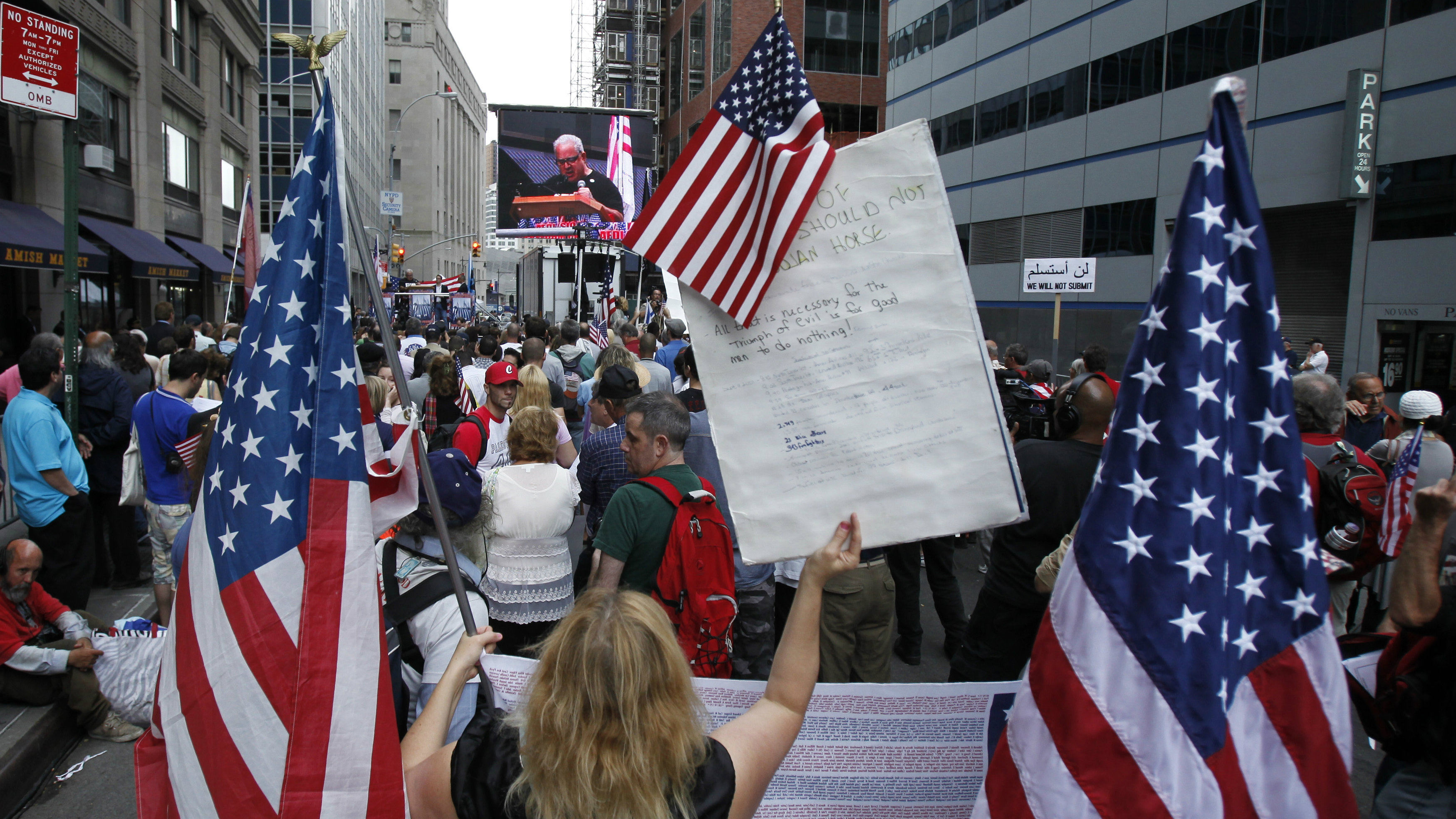 "Supporters at a ""Freedom Rally"" wave U.S. flags in support of not building a mosque near Ground Zero..."
