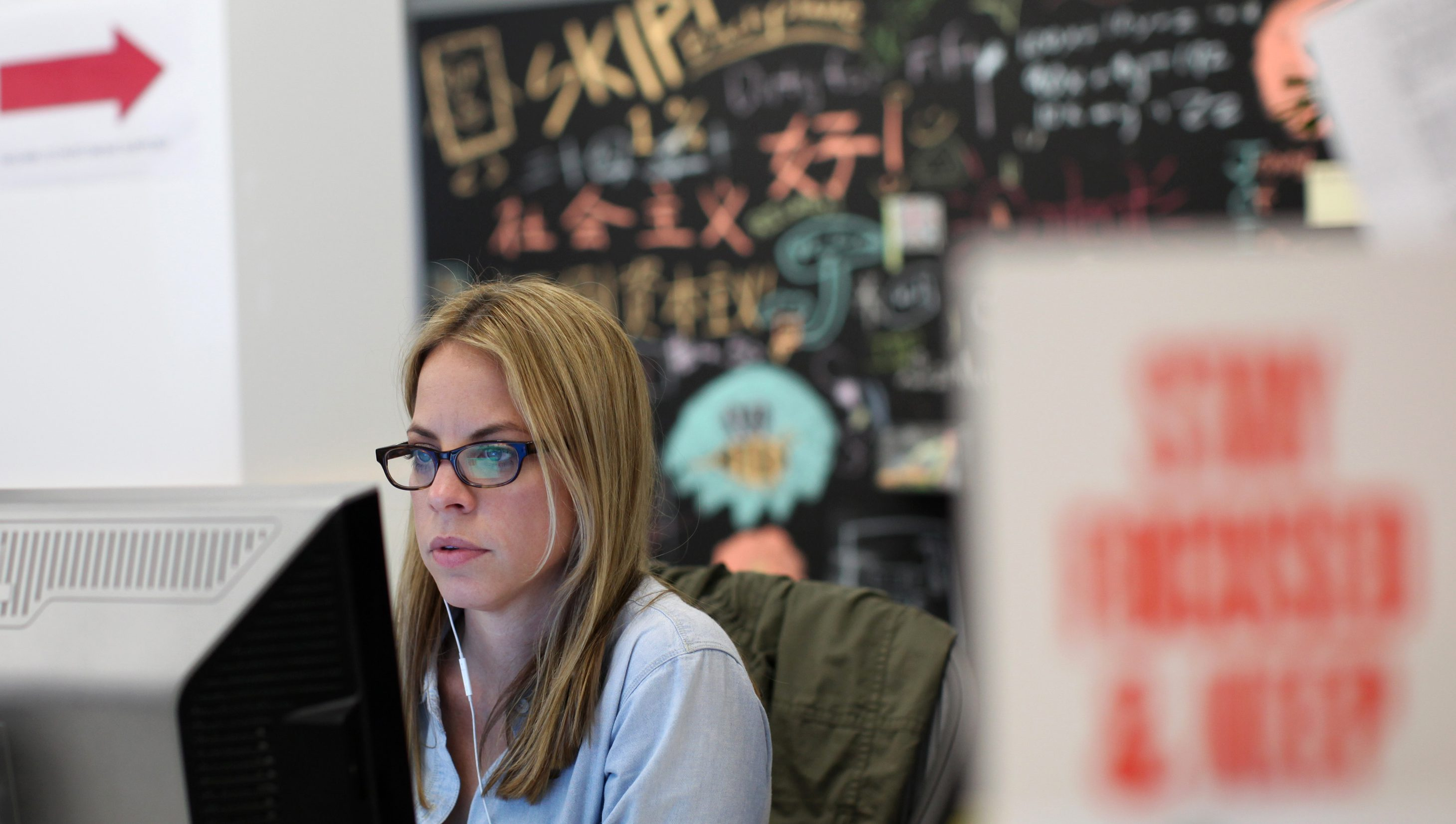"""A Facebook employee works in the design studio at the company's headquarters in Menlo Park, California March 2, 2012. Famous for a culture that glorifies the """"hacker way,"""" Facebook now talks of integrating """"design thinking"""" into its products and has steadily beefed up its design studio. Design chief Kate Aronowitz dispatches designers who are paired with an engineer, a product manager and sometimes a researcher to conceive new products or improve features such as user profiles or messages. Picture taken March 2, 2012. To match Feature DESIGNERS-STARTUP/     REUTERS/Robert Galbraith  (UNITED STATES - Tags: SCIENCE TECHNOLOGY BUSINESS) - RTR30OBT"""