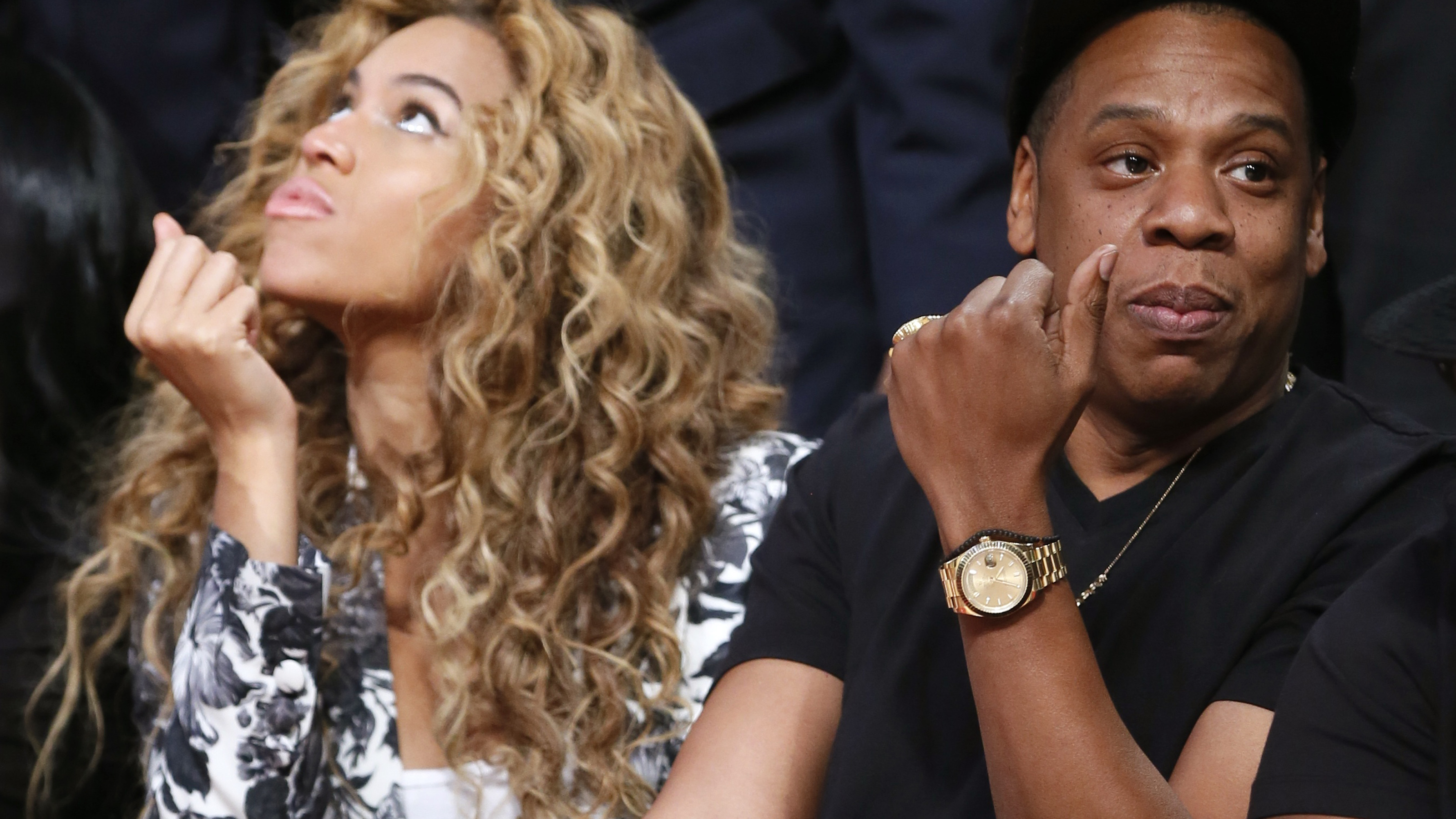 Singer Beyonce and her husband Jay-Z sit courtside before the NBA All-Star basketball game in Houston, Texas, February 17, 2013. REUTERS/Lucy Nicholson (UNITED STATES  - Tags: SPORT BASKETBALL)   - RTR3DXRW