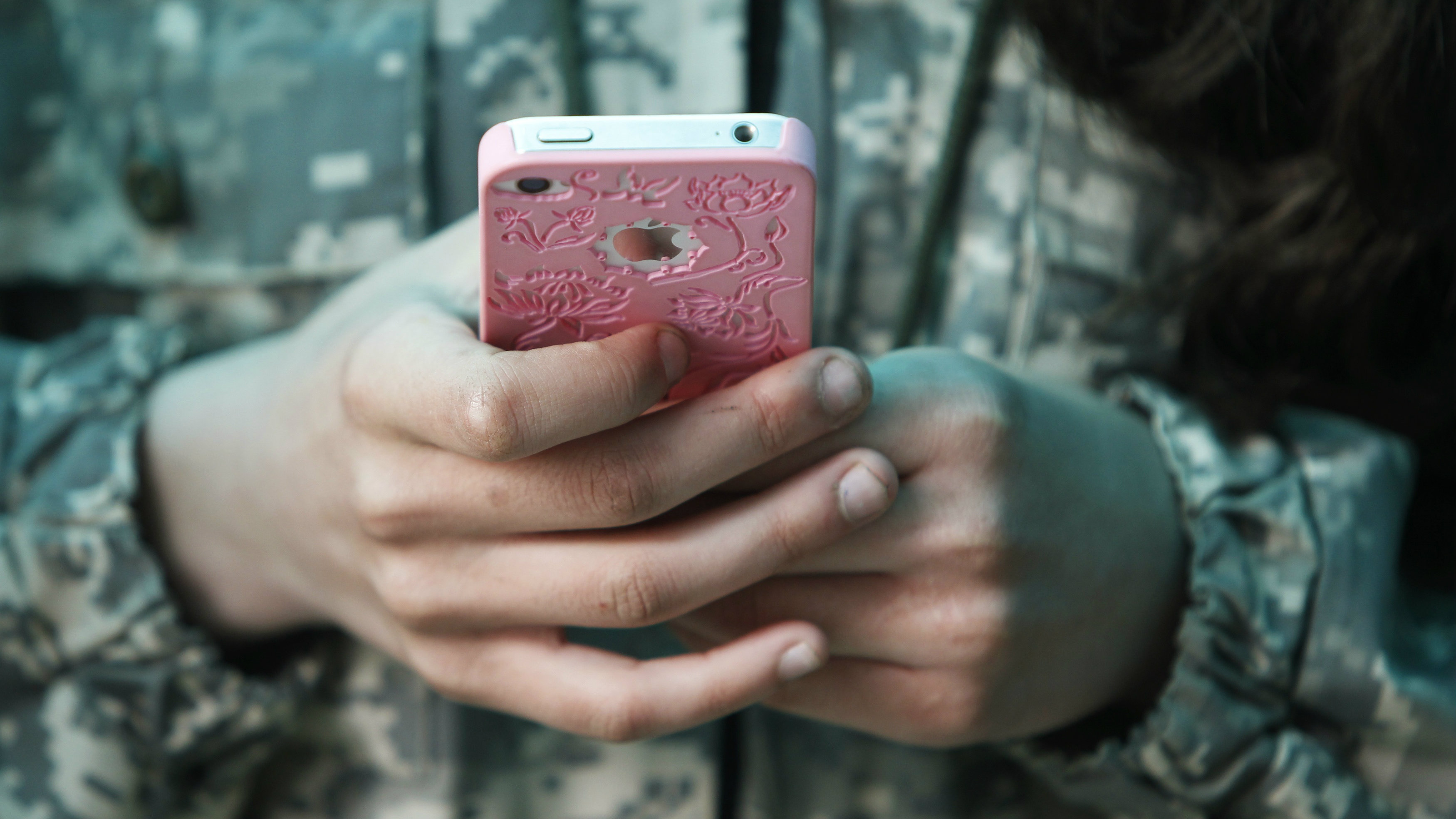 A student from the General Yermolov Cadet School plays with her mobile phone during a two-day field exercise.