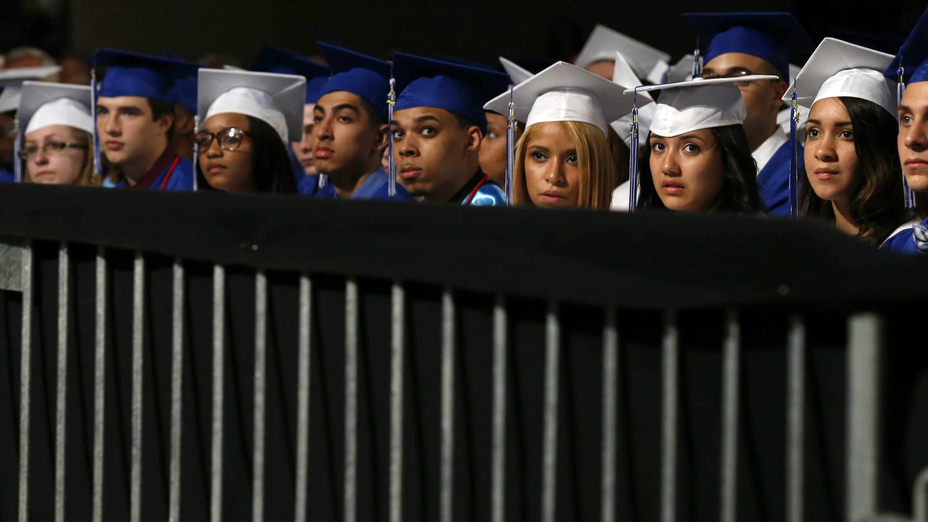 Students listen as U.S. President Obama delivers commencement address at Worcester Technical High School