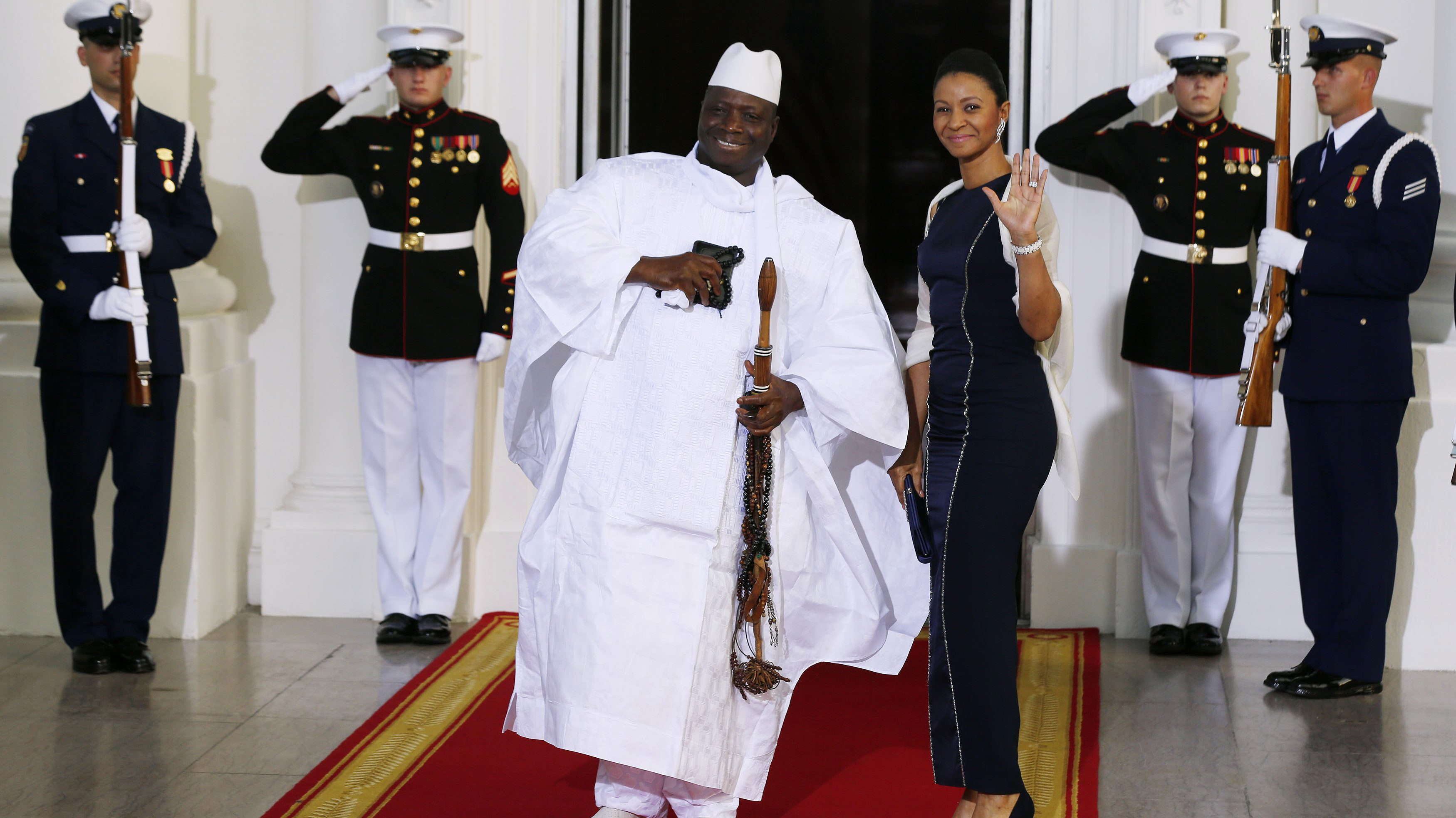 Republic of the Gambia's President Jammeh and his wife arrive for the official U.S.-Africa Leaders Summit dinner hosted by U.S. President Barack Obama at the White House in Washington