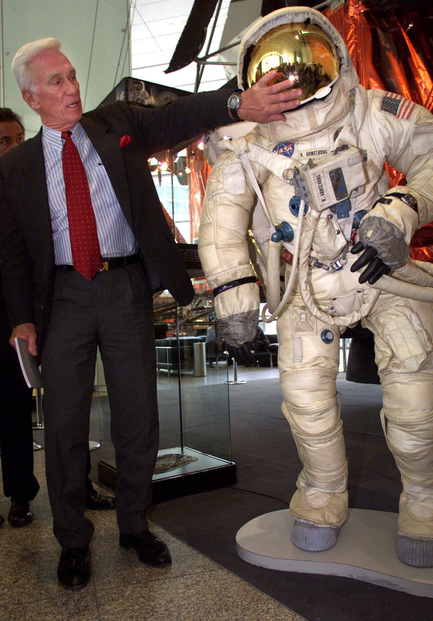 Eugene Cernan, the last man to walk on the moon, touches the visor of the helmet of NASA astronaut Neil Armstrong, first man on the moon at an exhibit in Frankfurt, July 20. The exhibtion marks the 30th anniversary of the Apollo 11 moonwalk.