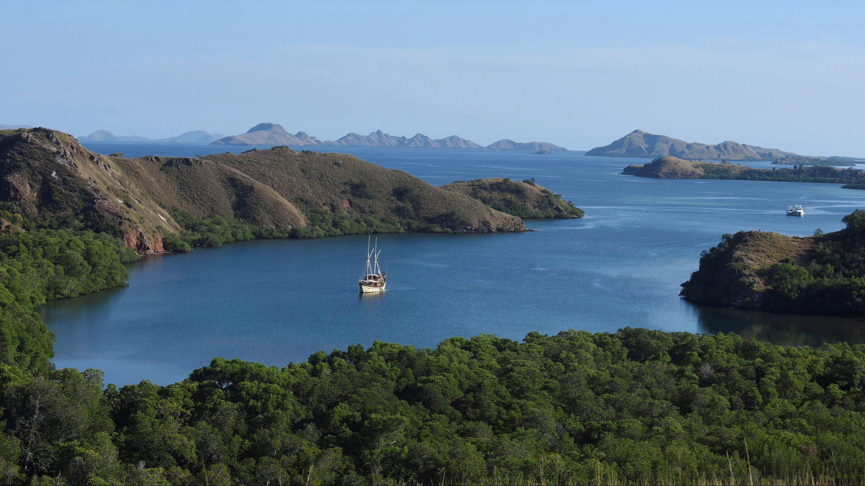 A tourist boat is seen off the shore of Rinca island in Komodo National Park, a popular tourist destination in eastern Indonesia May 24, 2016 in this photo taken by Antara Foto.