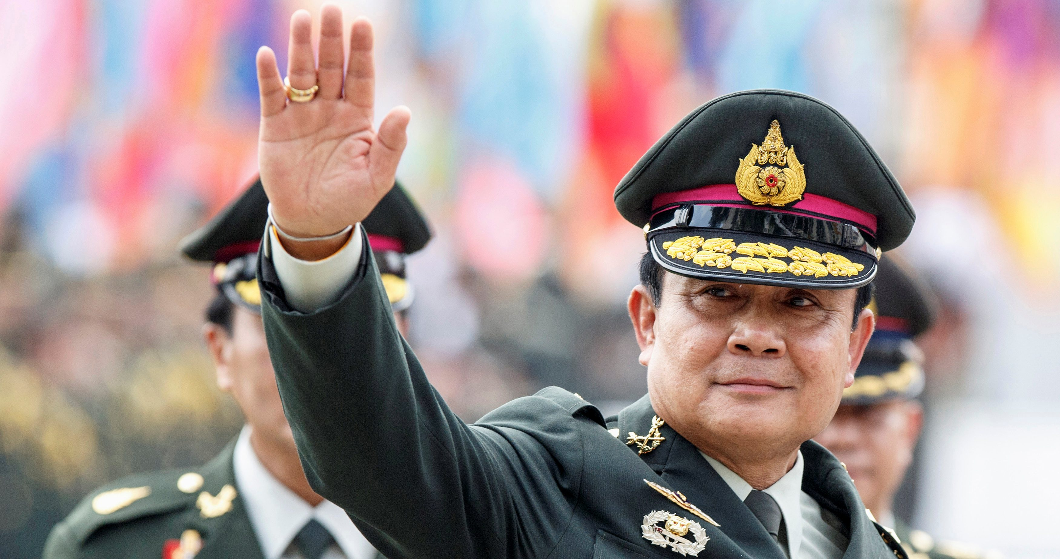 Thailand's prime minister Prayuth Chan-ocha waves after a handover ceremony for the new Royal Thai Army Chief at the Thai Army Headquarters in Bangkok, September 30, 2014.