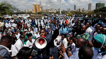 Ouma Oluga, Secretary-General of the Kenya Medical Practitioners, Pharmacists and Dentist Union (KMPDU), addresses doctors during a strike to demand fulfilment of a 2013 agreement between their union and the government that would raise their pay and improve working conditions outside Ministry of Health headquarters in Nairobi, Kenya December 5, 2016.