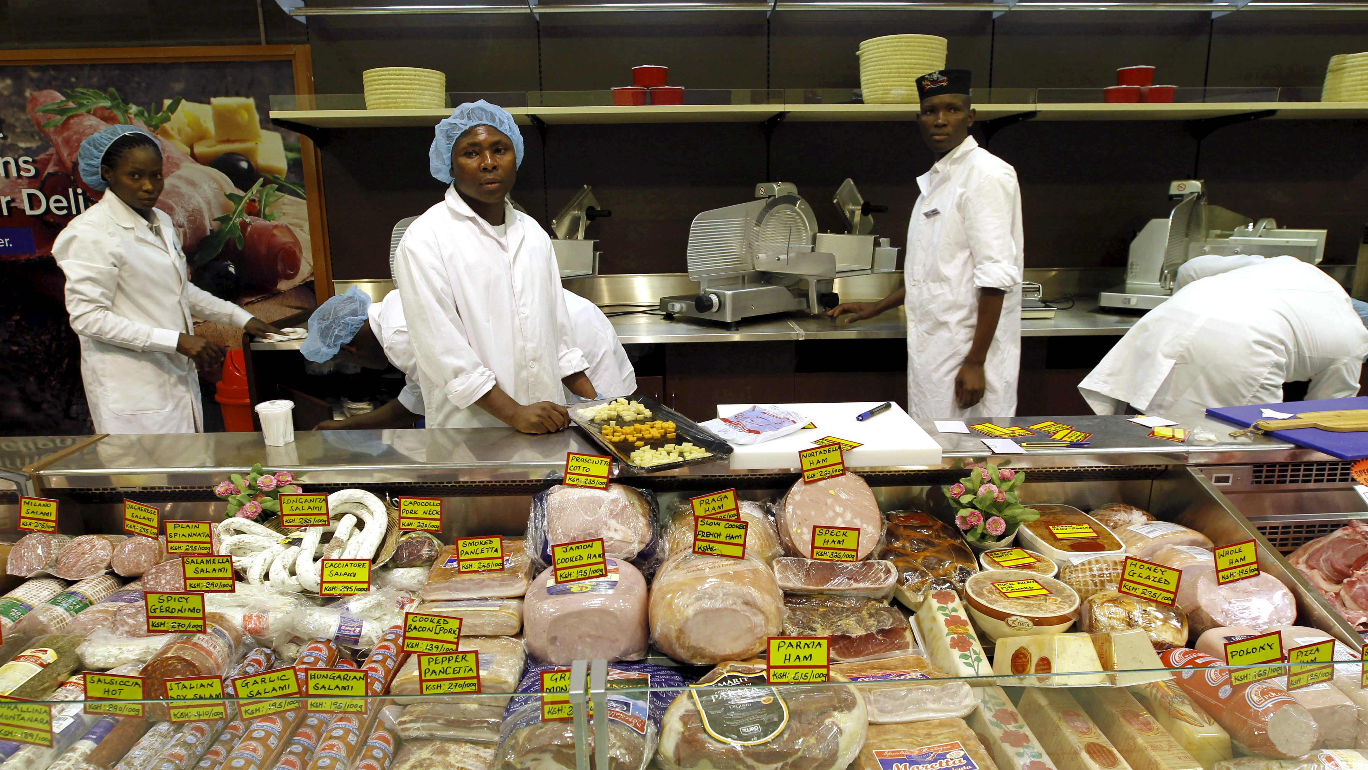 Workers arrange meat products inside the Nakumatt supermarket in the reopened Westgate shopping mall in Kenya's capital Nairobi