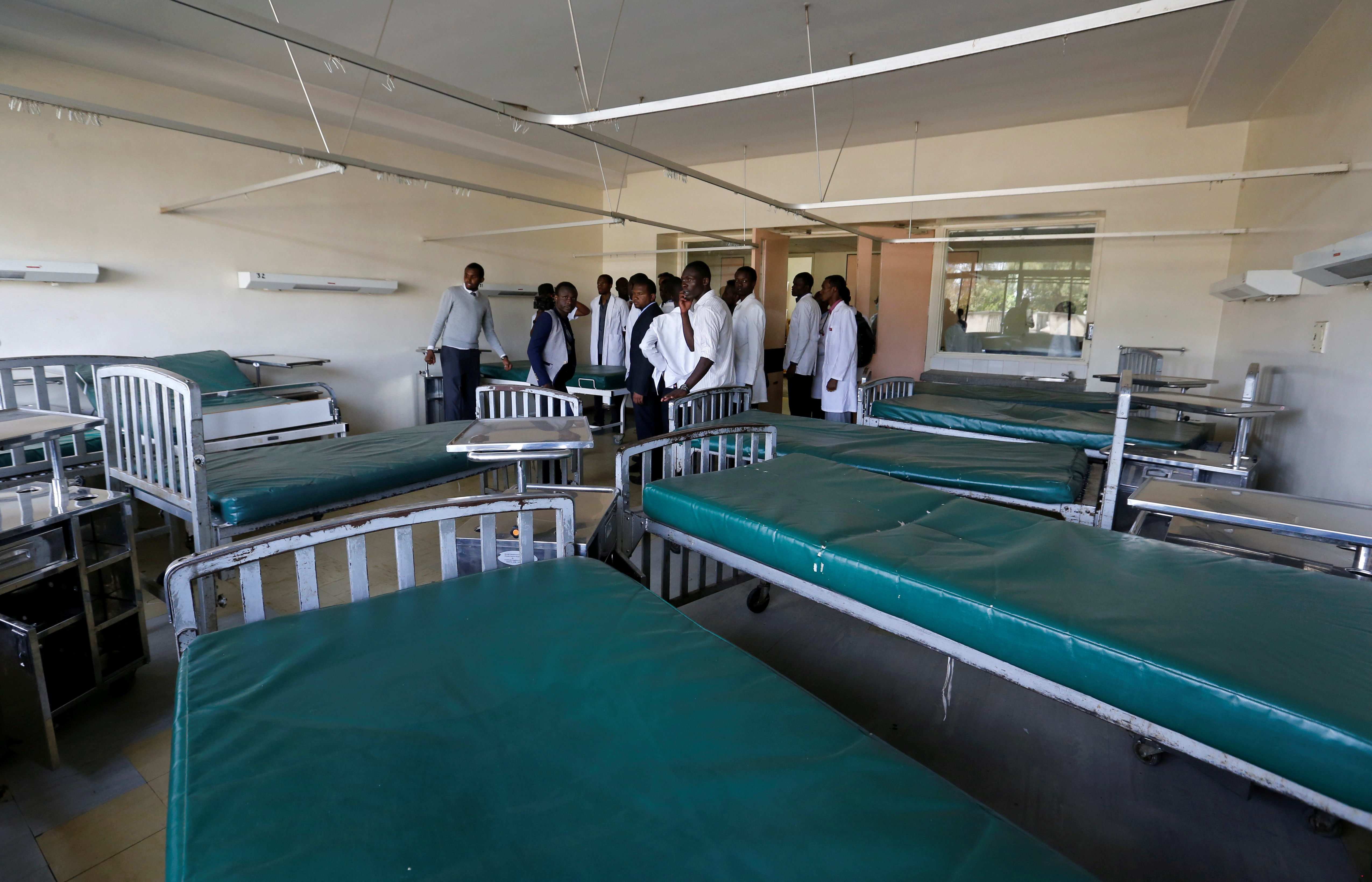 Kenyan student doctors gather inside a deserted labour ward at the Kenyatta National Hospital during a doctors' strike to demand fulfilment of a 2013 agreement between doctors' union and the government that would raise the medical practitioners pay and improve working conditions in Nairobi, Kenya, January 19, 2017.