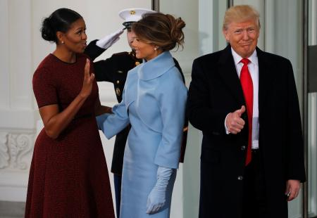 U.S. first lady Michelle Obama (L) greets U.S. President-elect Donald Trump (R) and his wife Melania for tea before the inauguration at the White House in Washington, U.S. January 20, 2017. REUTERS/Jonathan Ernst - RTSWH9R