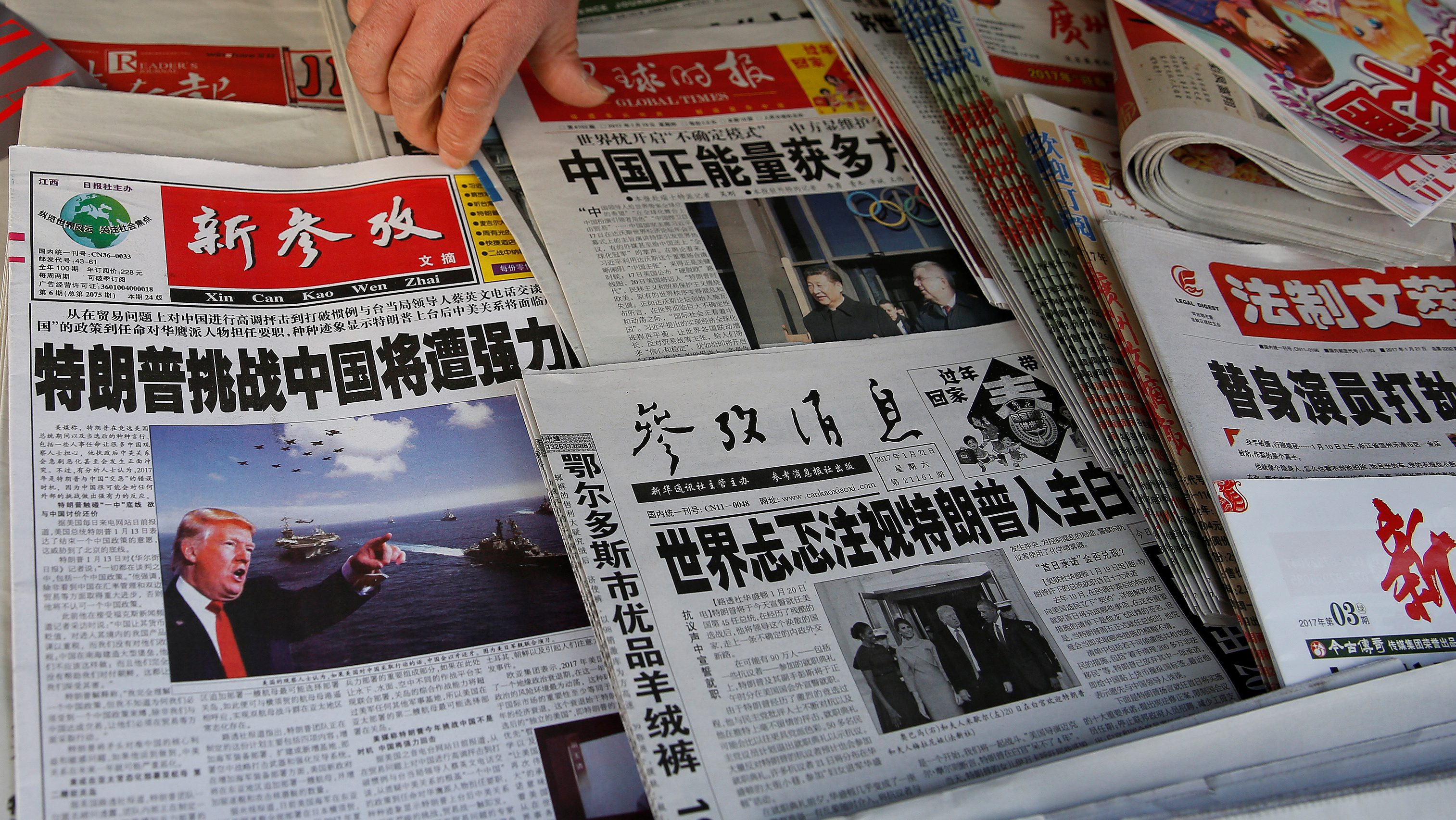 Chinese news papers showing U.S. President Donald J. Trump at a newsstand in Shanghai, China January 21, 2017. REUTERS/Aly Song          FOR EDITORIAL USE ONLY. NO RESALES. NO ARCHIVES. - RTSWMC5