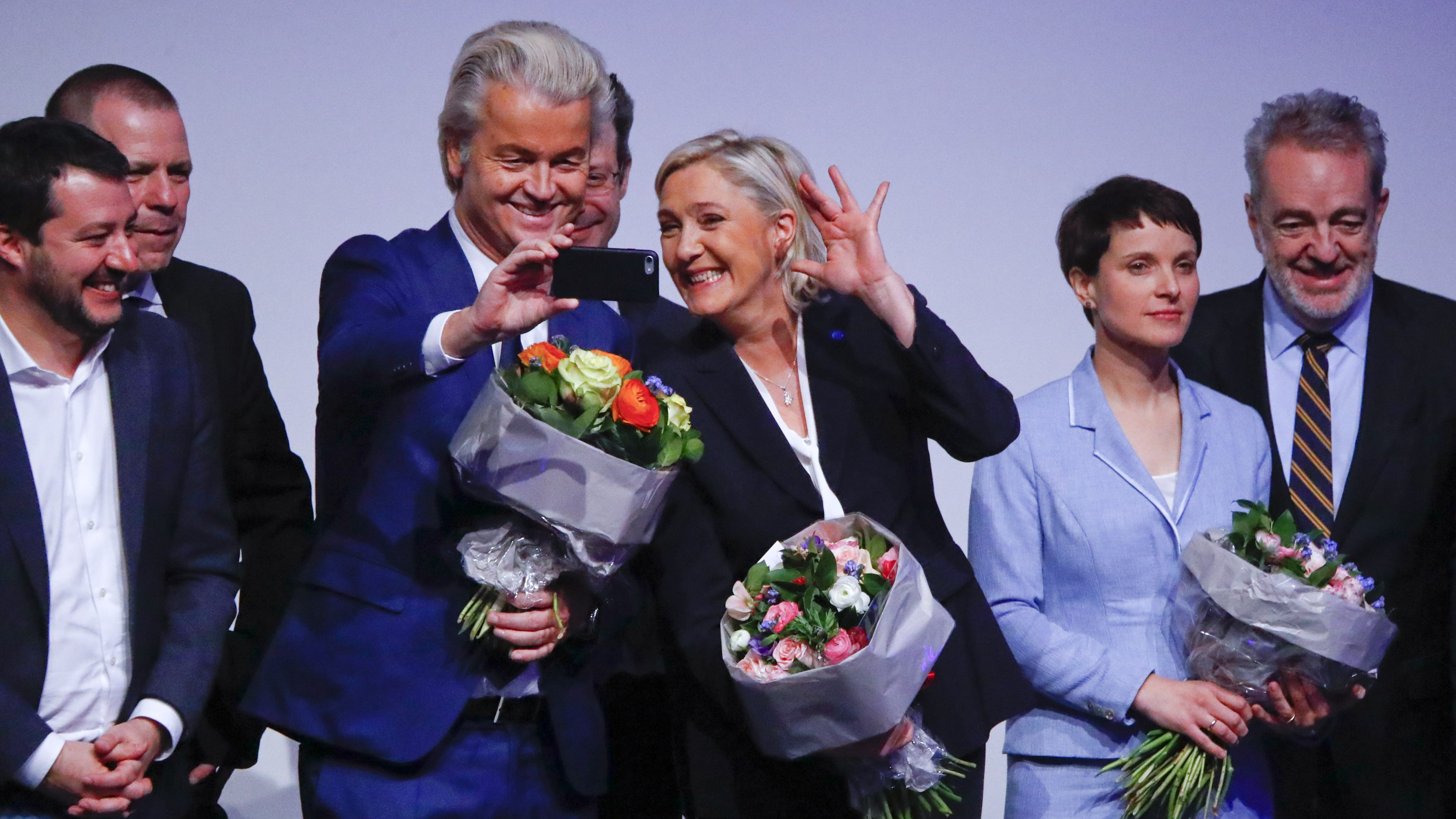 France's National Front leader Marine Le Pen and Netherlands' Party for Freedom (PVV) leader Geert Wilders take a Selfie during a European far-right leaders meeting