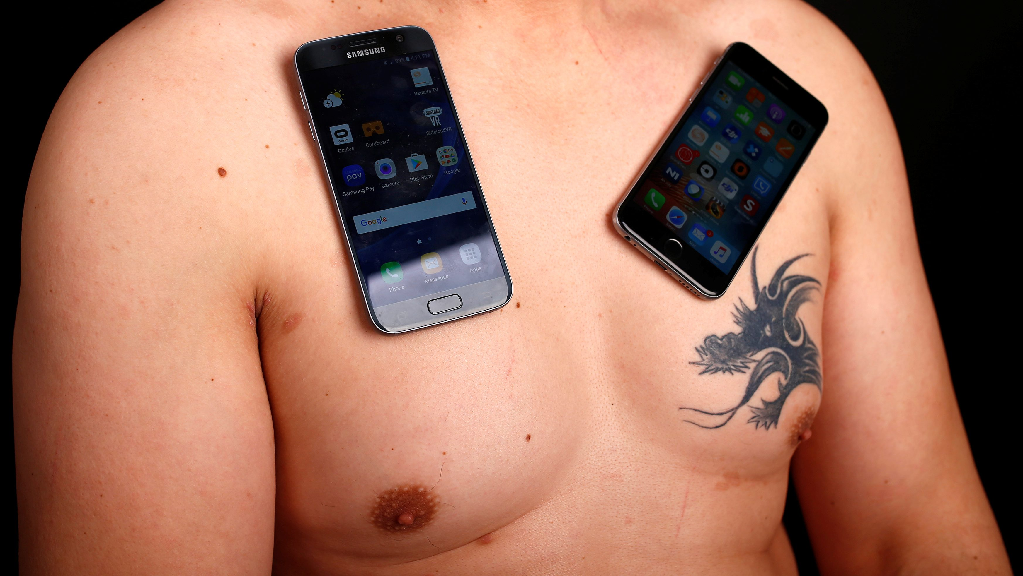 Nermin Halilagic, 38, poses with smartphones in Bihac, Bosnia and Herzegovina, January 23, 2017. Halilagic discovered earlier this year that he had the unusual ability to attach items to his body using what he says is a special energy radiated from his body. Without making any special preparation, he says he is able to hold on to spoons, forks, knives, and other kitchen appliances, as well as non-metal objects like remote controls, all plastic stuff, and cell phones. Picture taken January 23, 2017. REUTERS/Dado Ruvic - RTSX4HV