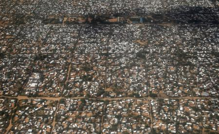 "An aerial picture shows a section of the Hagadera camp in Dadaab near the Kenya-Somalia border, May 8, 2015. Kenya's government threatened to close the Dadaab refugee camp, which with about 350,000 Somali refugees is the world's biggest refugee camp, as a security risk. The United Nations refugee agency urged Kenya to reconsider an order to close the teeming Dadaab refugee camp, warning that sending Somali refugees back to their homeland would have ""extreme humanitarian and practical consequences""."