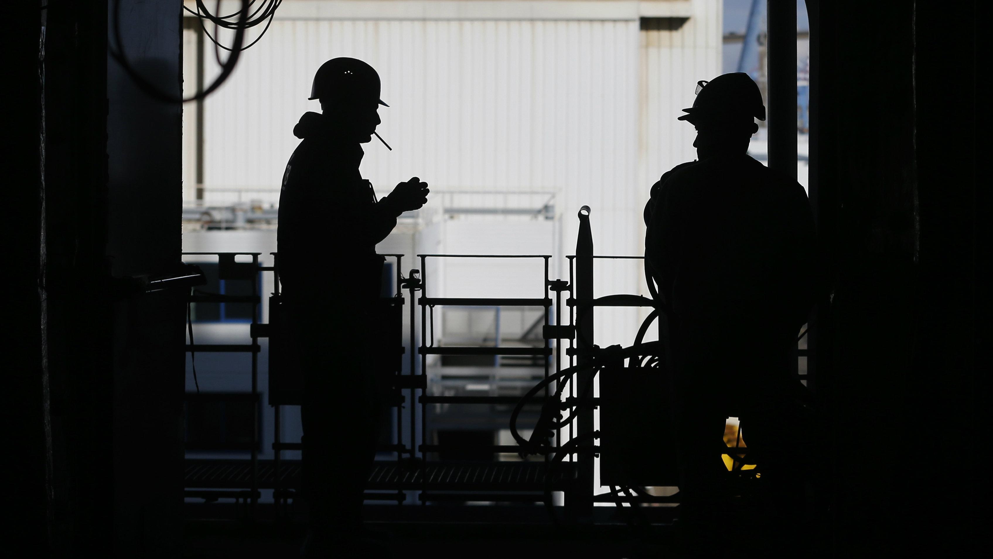 Shipbuilders take a break at a shipyard.